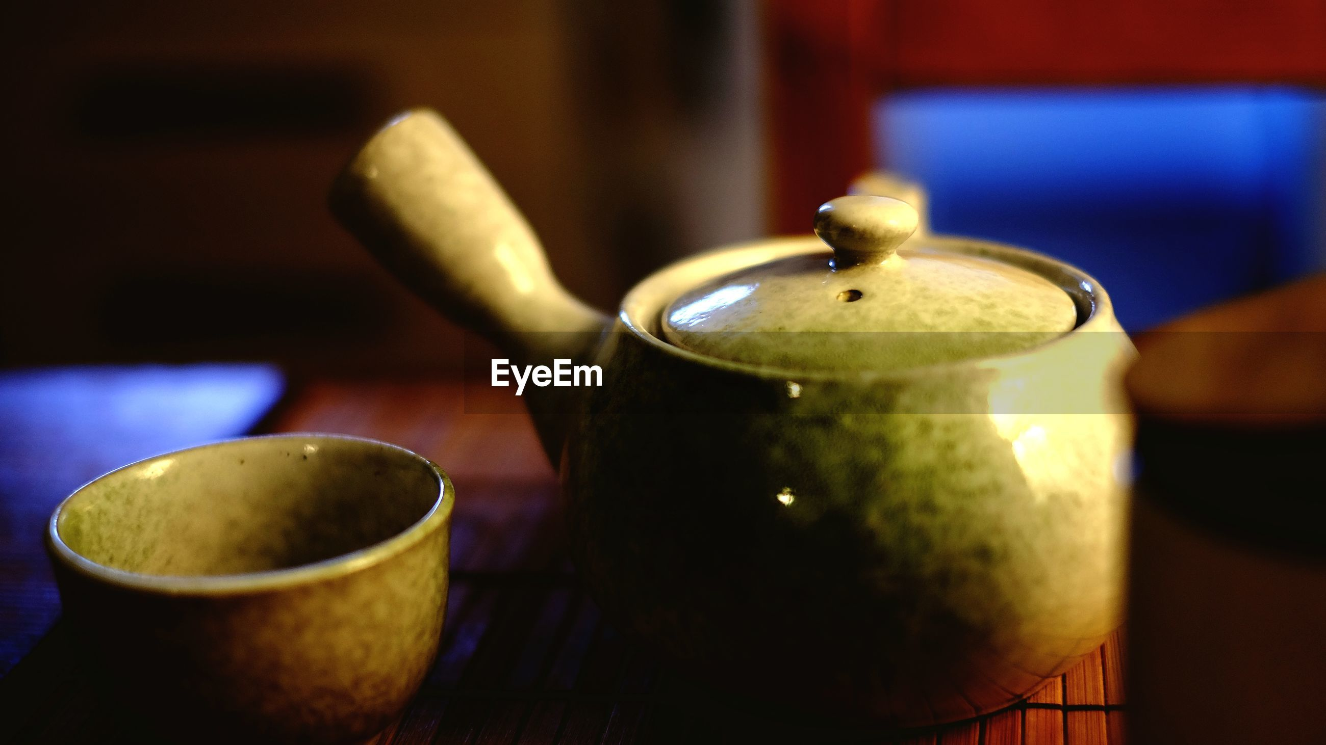 Close-up of teapot and cup on table