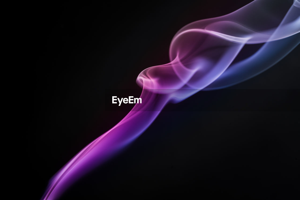 black background, studio shot, close-up, indoors, smoke - physical structure, motion, copy space, no people, burning, abstract, flame, nature, cut out, swirl, illuminated, changing form, pattern, purple, heat - temperature, long exposure