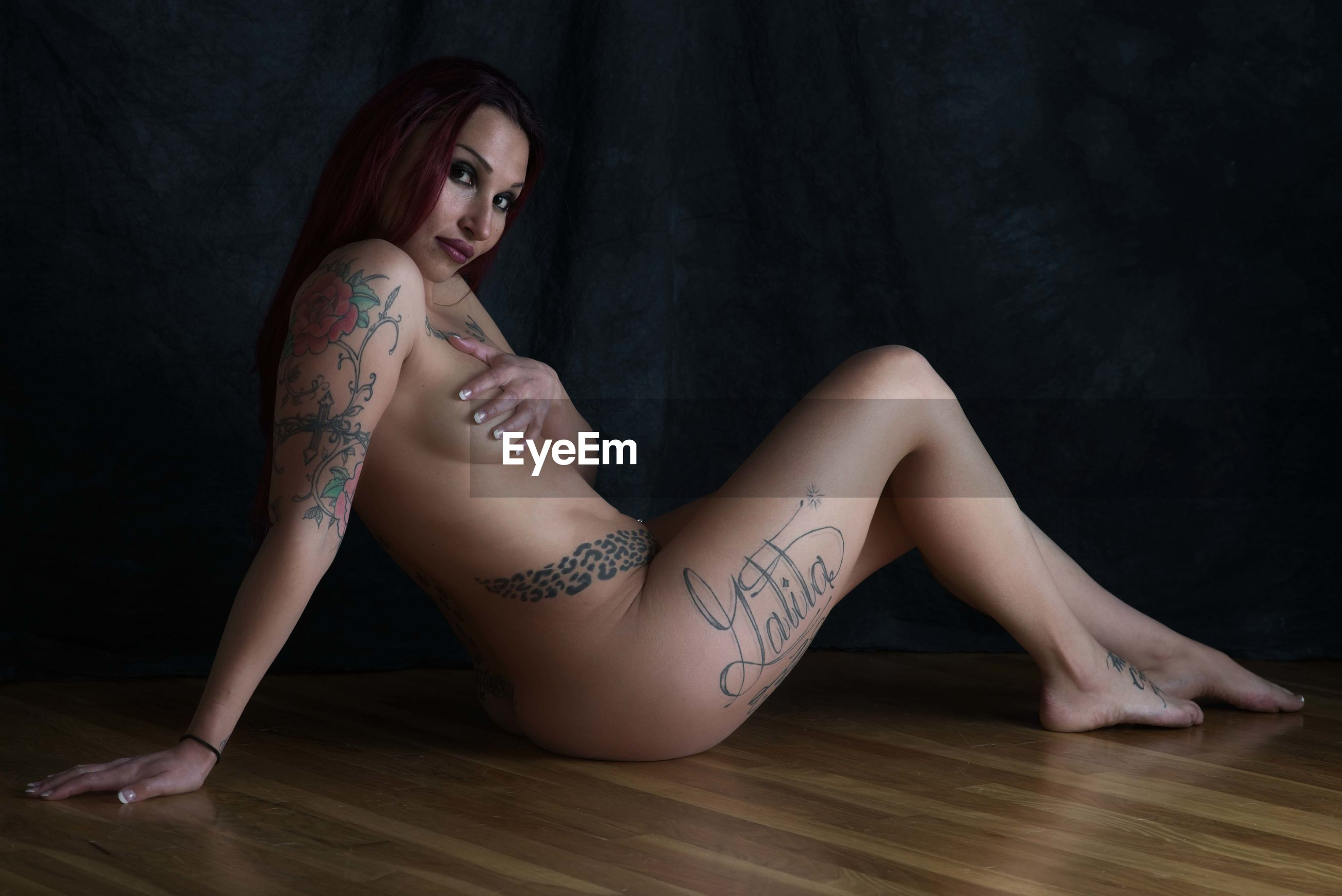 young adult, young women, tattoo, indoors, one person, women, beautiful woman, sitting, beauty, lifestyles, adult, real people, full length, portrait, fashion, leisure activity, flooring, hairstyle, wood, lingerie