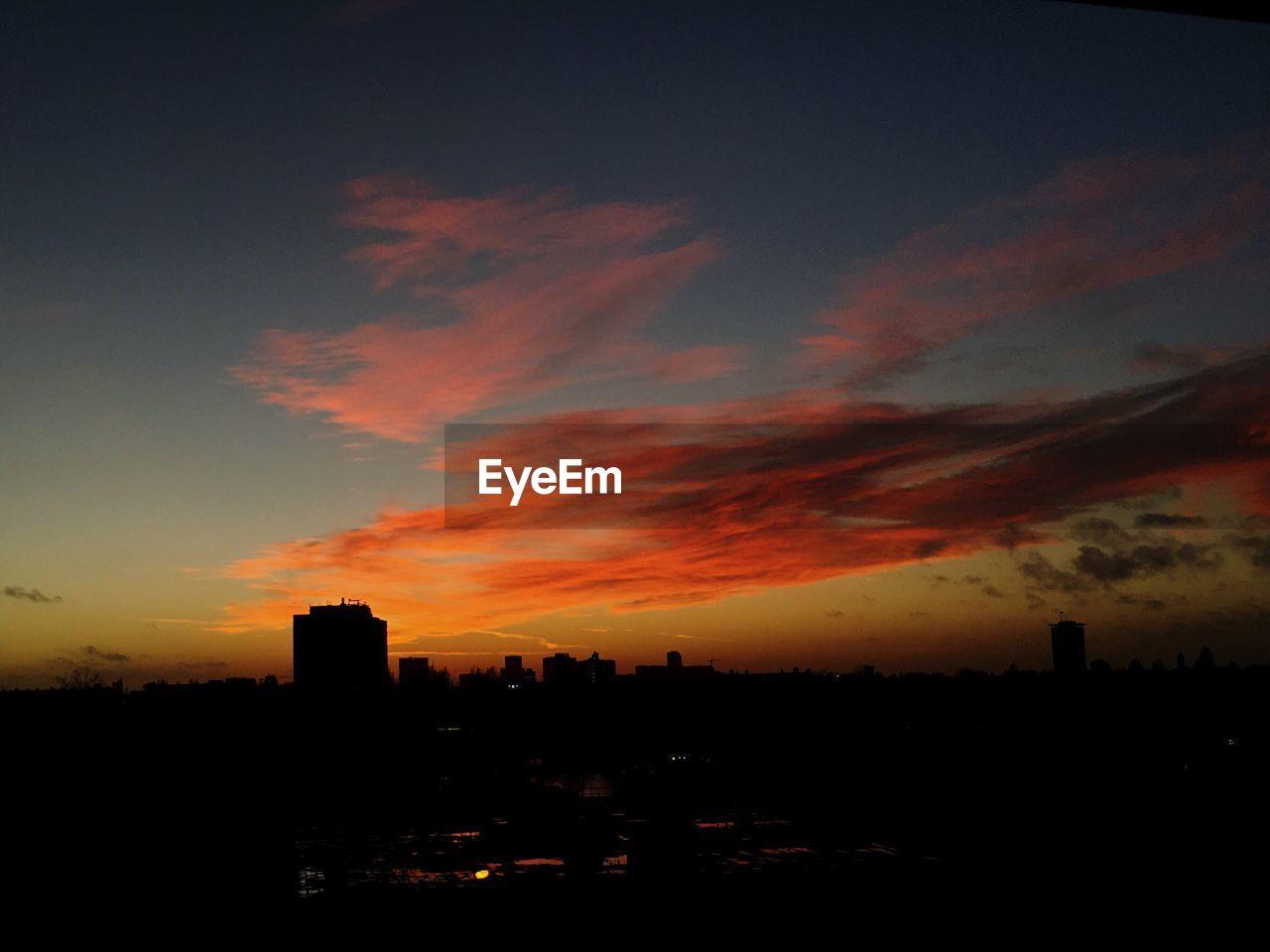 sunset, silhouette, sky, building exterior, architecture, orange color, cloud - sky, cityscape, built structure, city, no people, skyscraper, nature, outdoors, travel destinations, beauty in nature, scenics, urban skyline