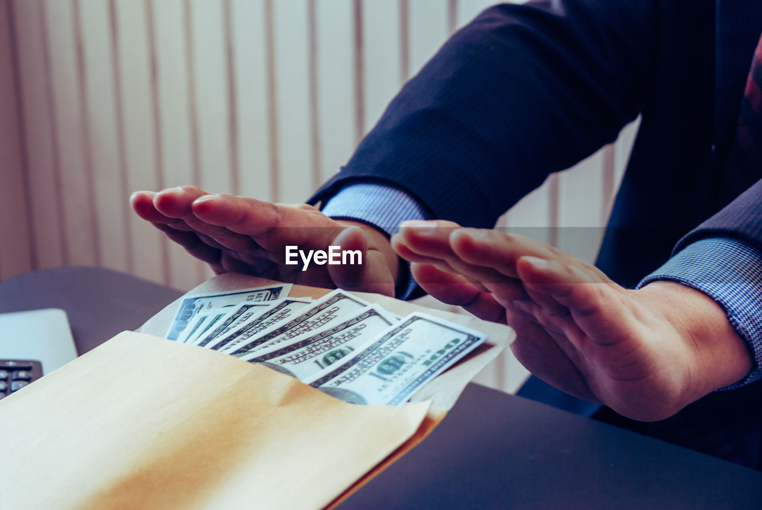 Midsection of person rejecting bribe