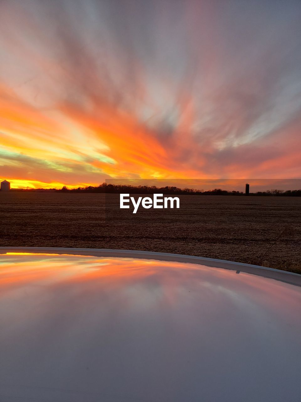 sunset, sky, orange color, scenics - nature, beauty in nature, cloud - sky, tranquility, tranquil scene, nature, idyllic, environment, no people, non-urban scene, landscape, transportation, land, water, outdoors, dramatic sky, field