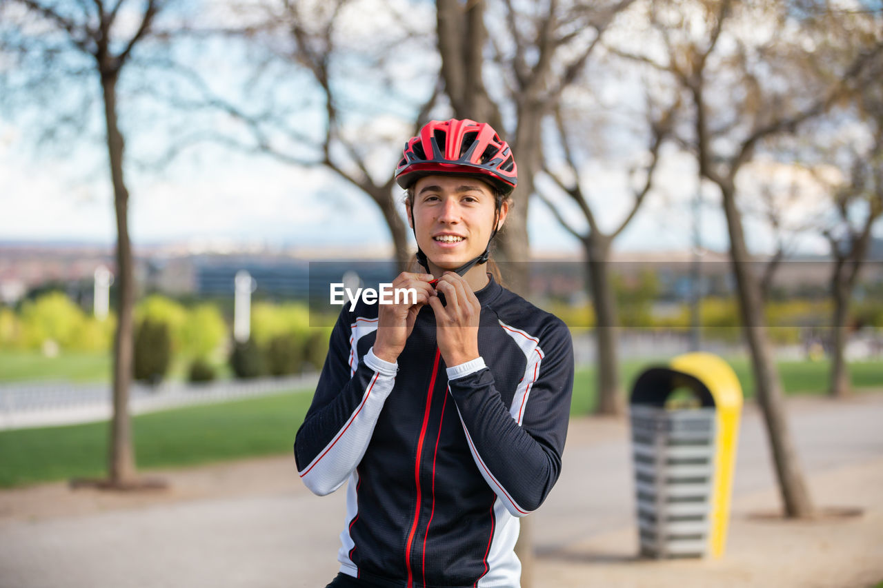 Portrait of young man wearing cycling helmet
