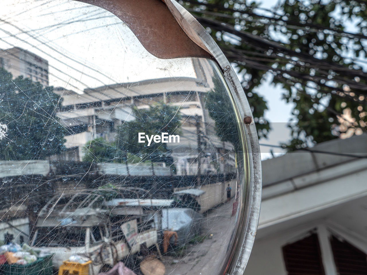 built structure, architecture, building exterior, tree, day, reflection, glass - material, focus on foreground, building, window, transparent, nature, plant, outdoors, house, no people, city, residential district, transportation, glass