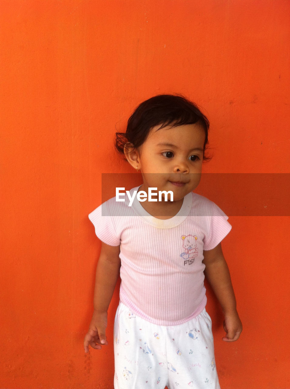 Portrait Of Girl On Orange Background