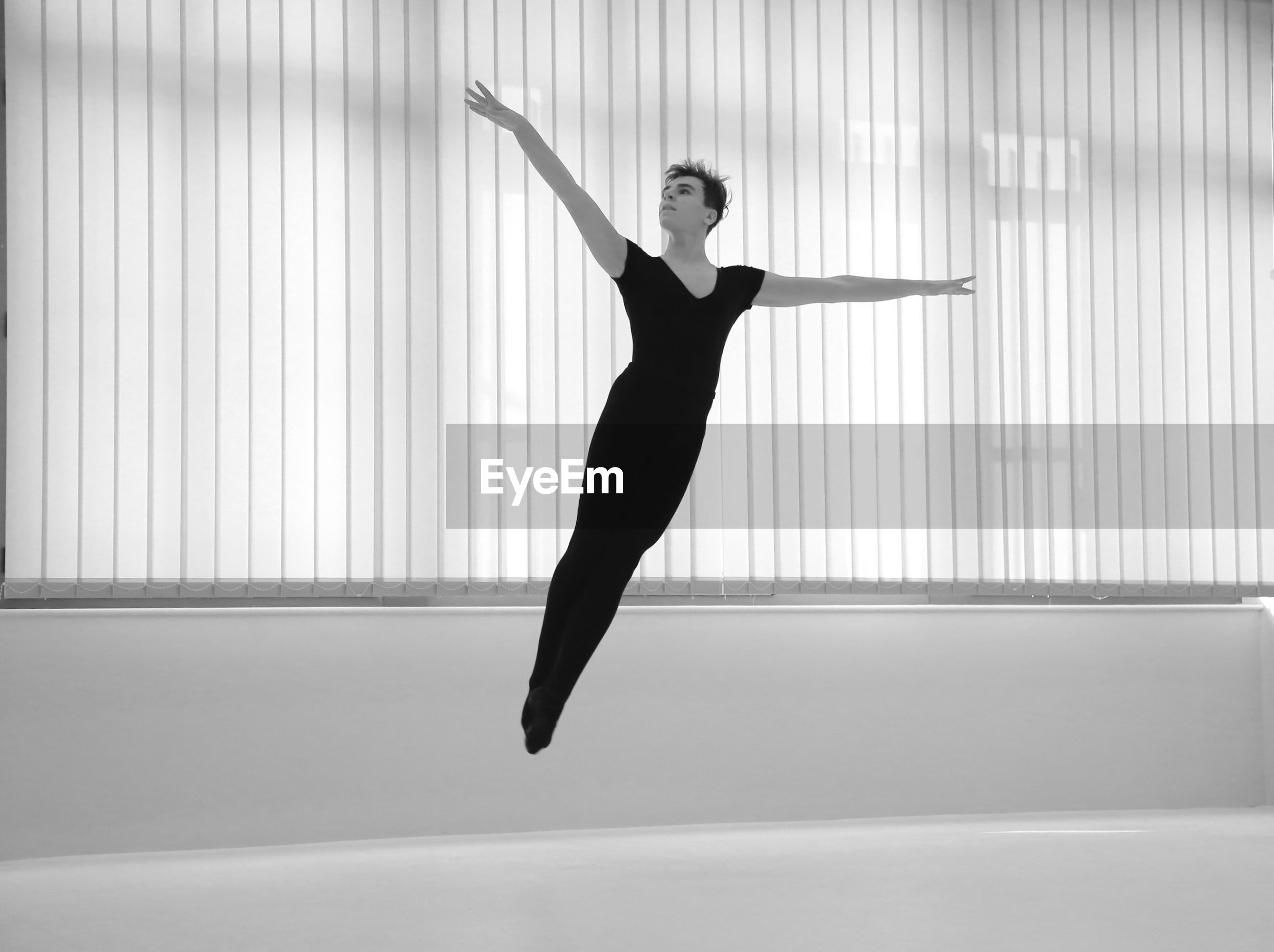 Full length of ballet dancer dancing in studio