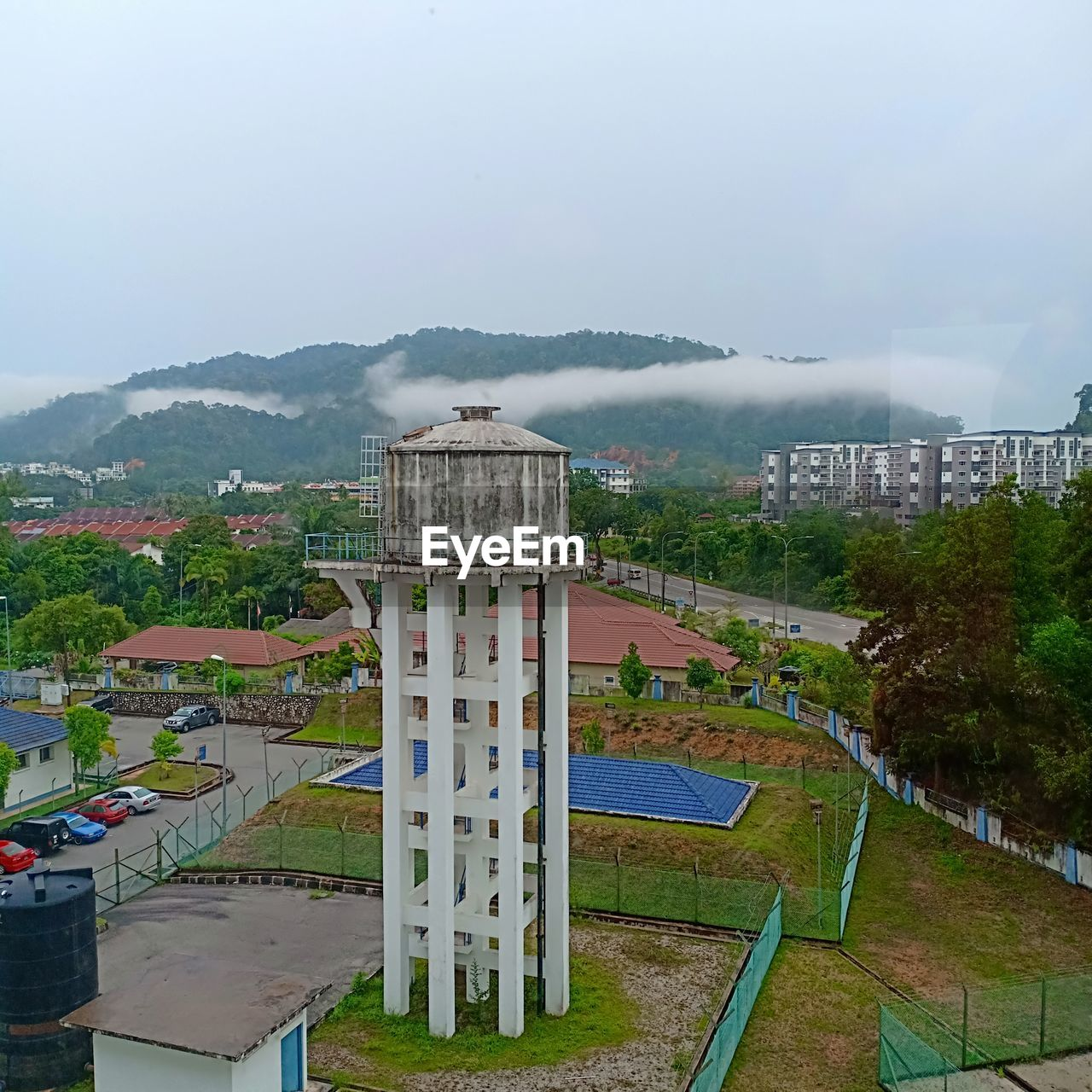 architecture, sky, built structure, mountain, nature, building exterior, plant, no people, day, fog, grass, outdoors, beauty in nature, tree, building, city, environment, land, scenics - nature