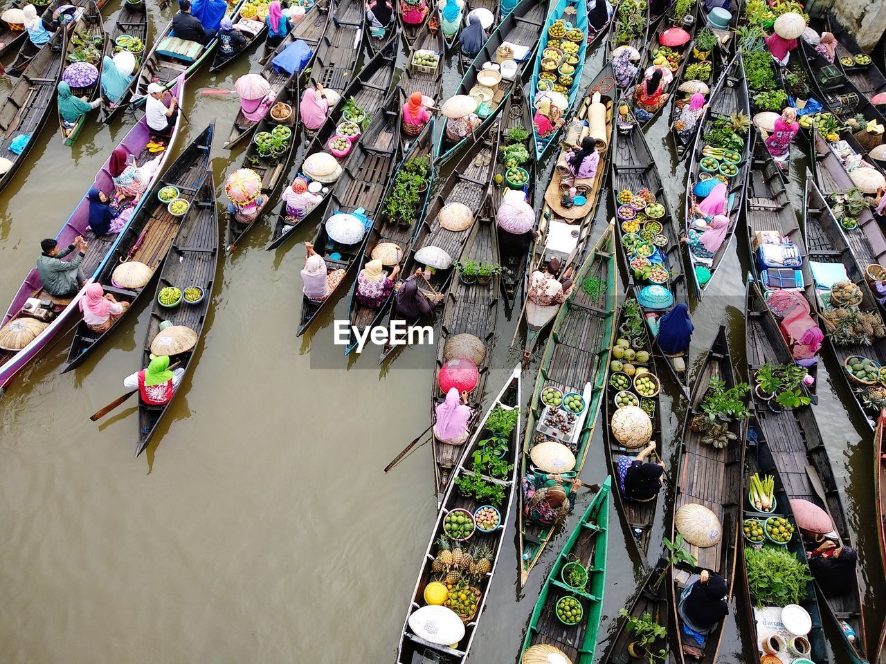 High angle view of market vendors sitting on rowboats in lake