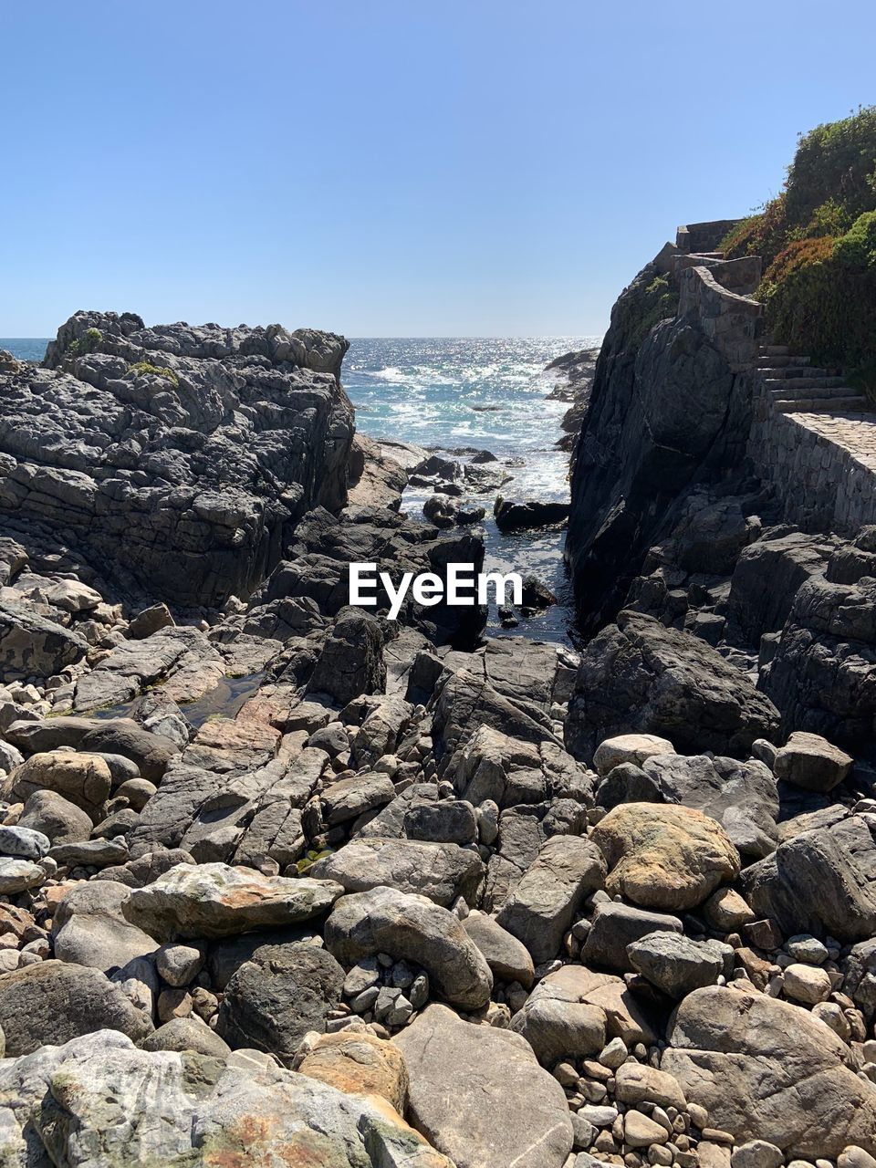 rock, water, rock - object, solid, sea, sky, land, beauty in nature, nature, beach, clear sky, day, scenics - nature, no people, motion, rock formation, tranquility, non-urban scene, outdoors, rocky coastline, power in nature