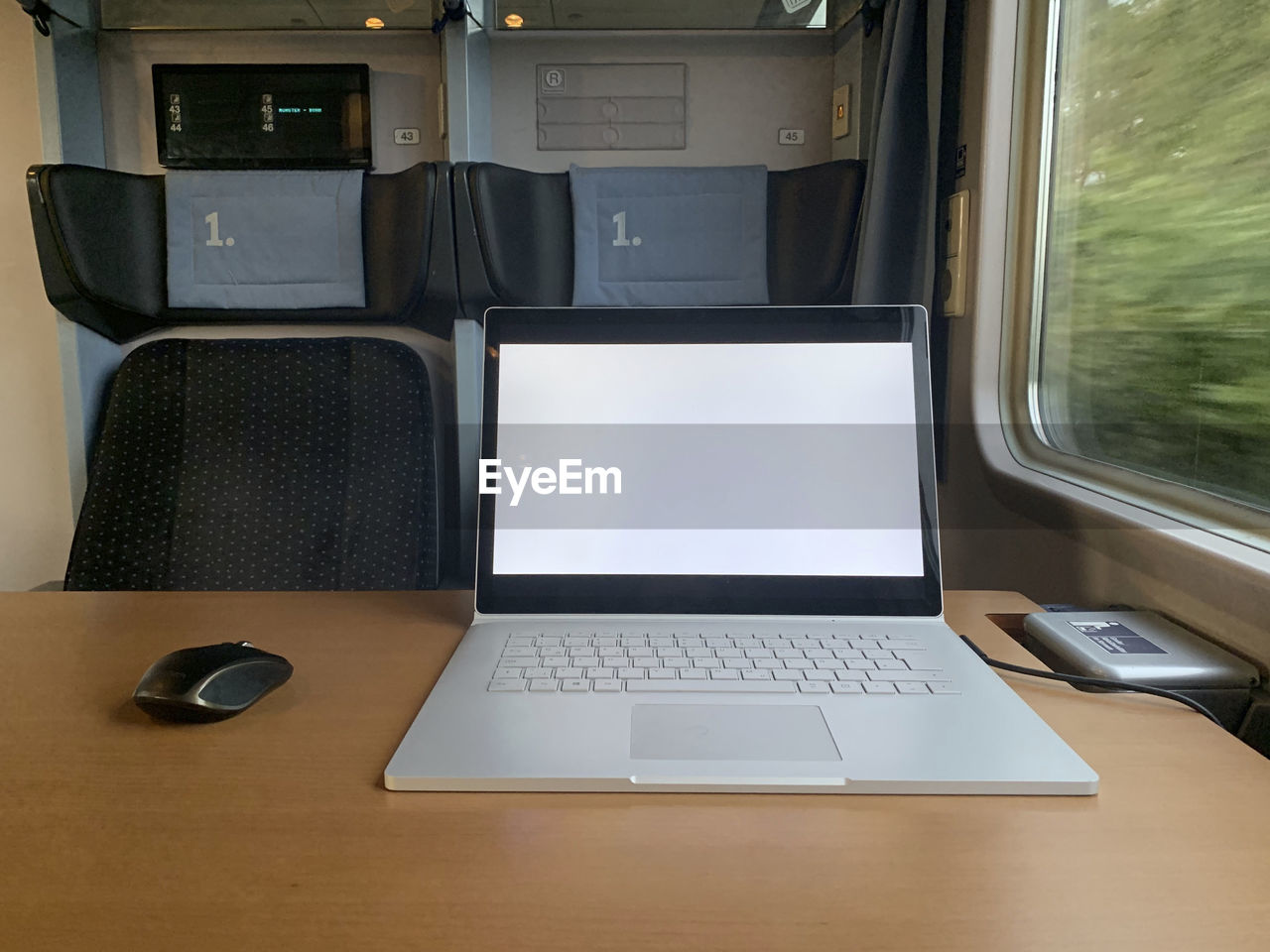 Laptop on table in train