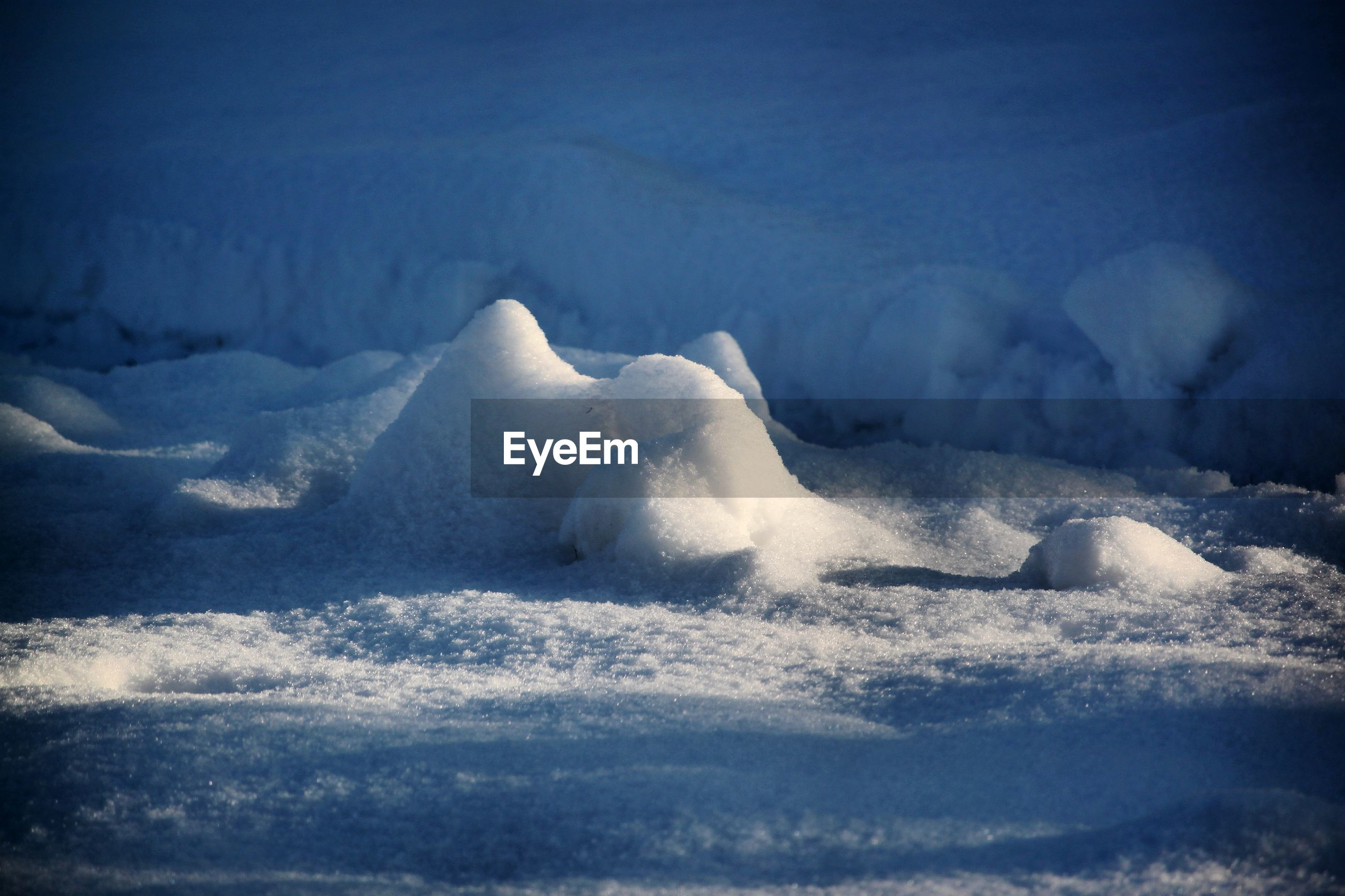 SCENIC VIEW OF FROZEN SEA FROM SNOW