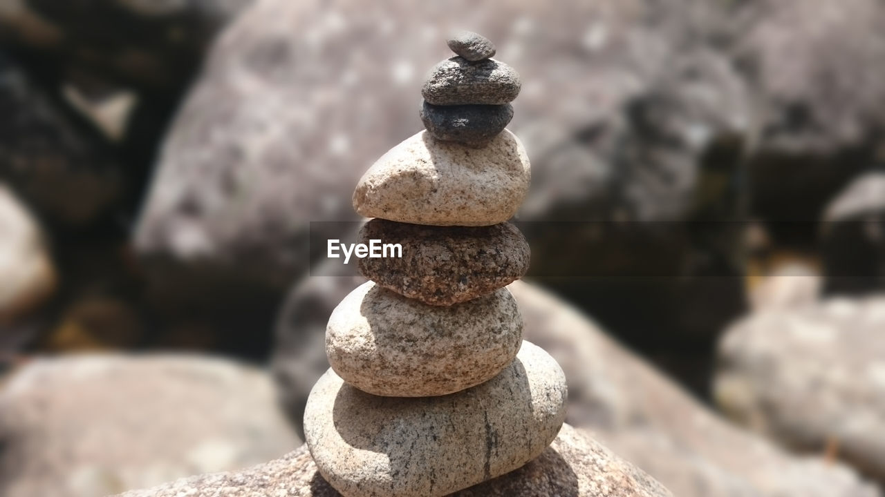 solid, balance, stone - object, stack, no people, focus on foreground, rock, zen-like, day, pebble, nature, close-up, rock - object, stone, outdoors, land, pattern, textured, still life, sunlight