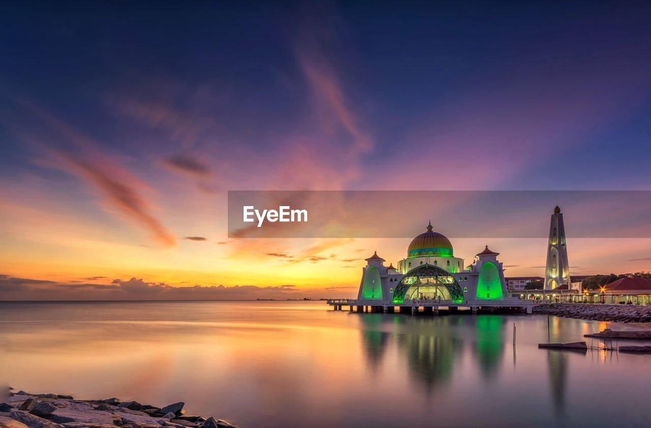 sunset, religion, dome, reflection, spirituality, built structure, place of worship, sky, water, architecture, building exterior, travel destinations, cloud - sky, no people, outdoors, nature, beauty in nature, day