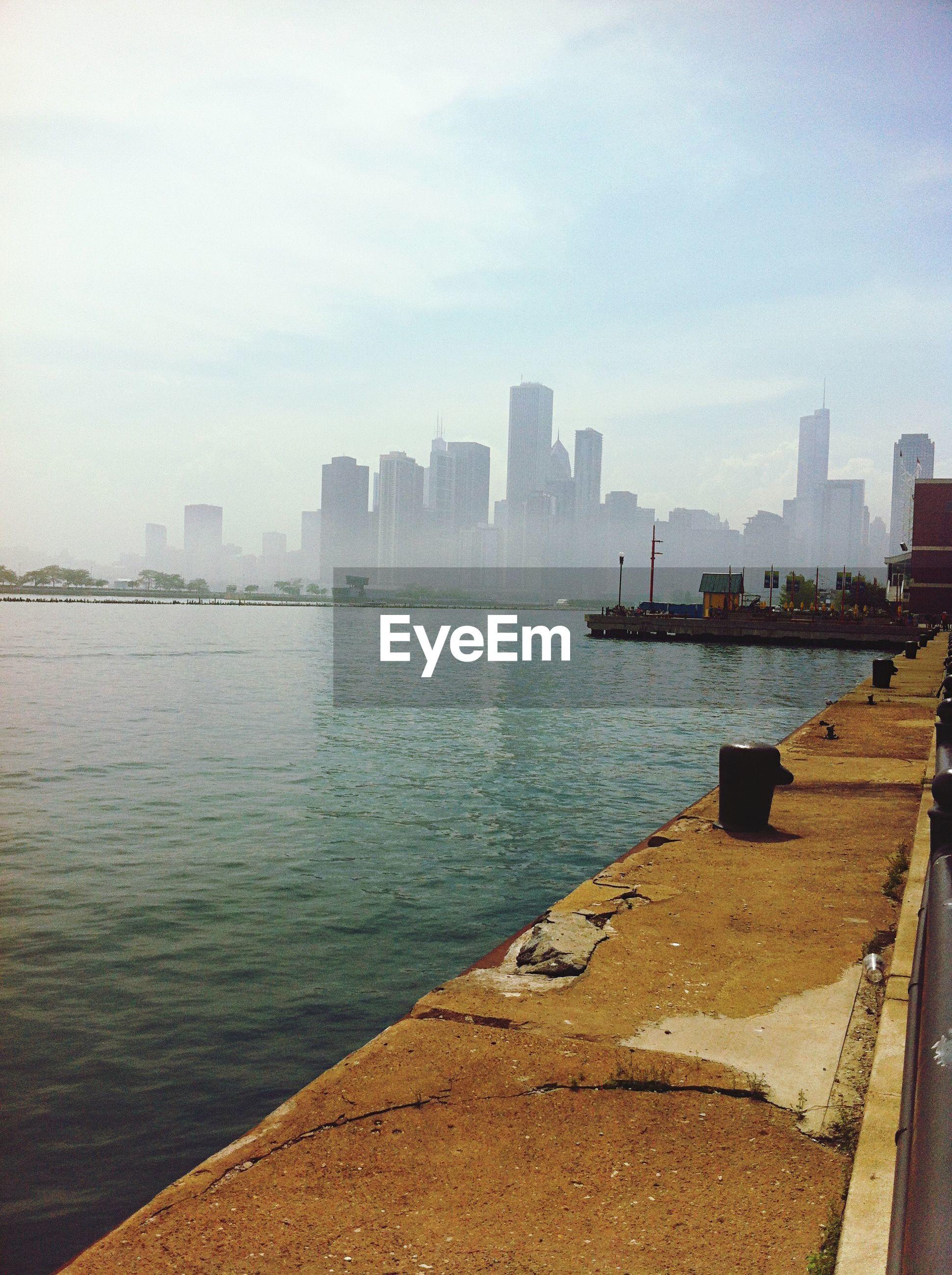 SEA BY CITY AGAINST SKY