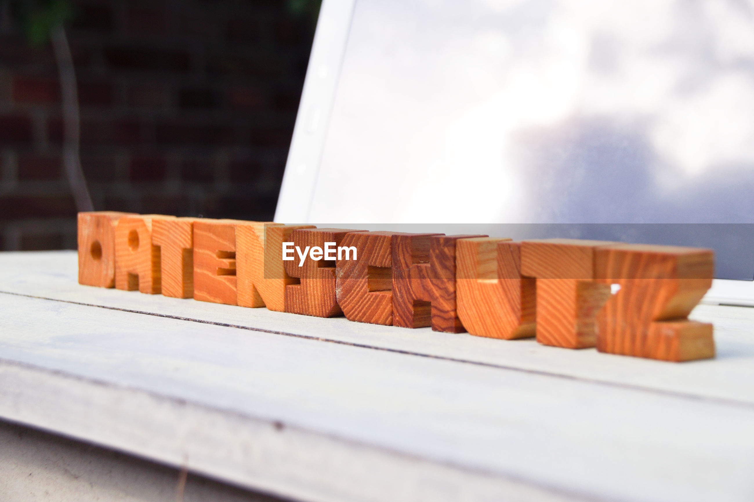 Close-up of wooden text on table