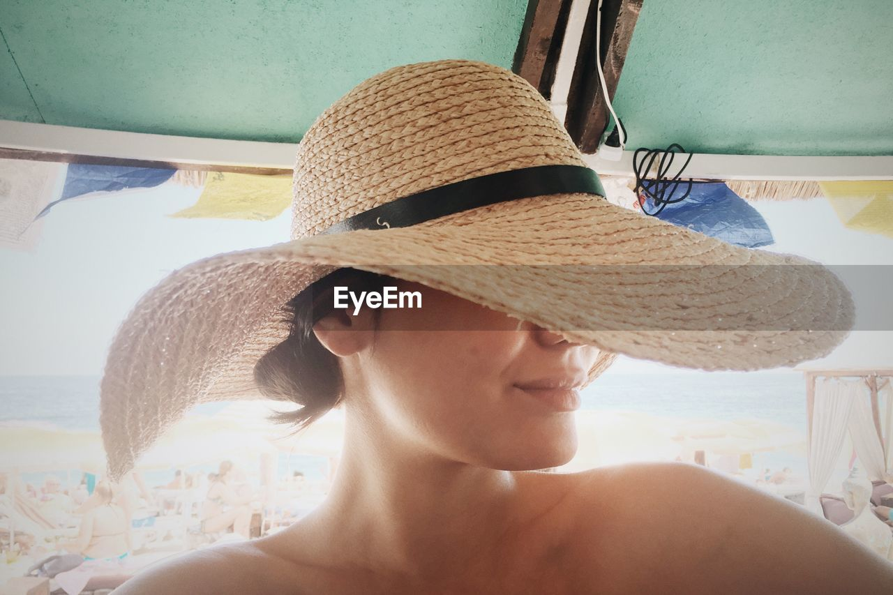 Close-Up Of Woman With Sun Hat At Beach