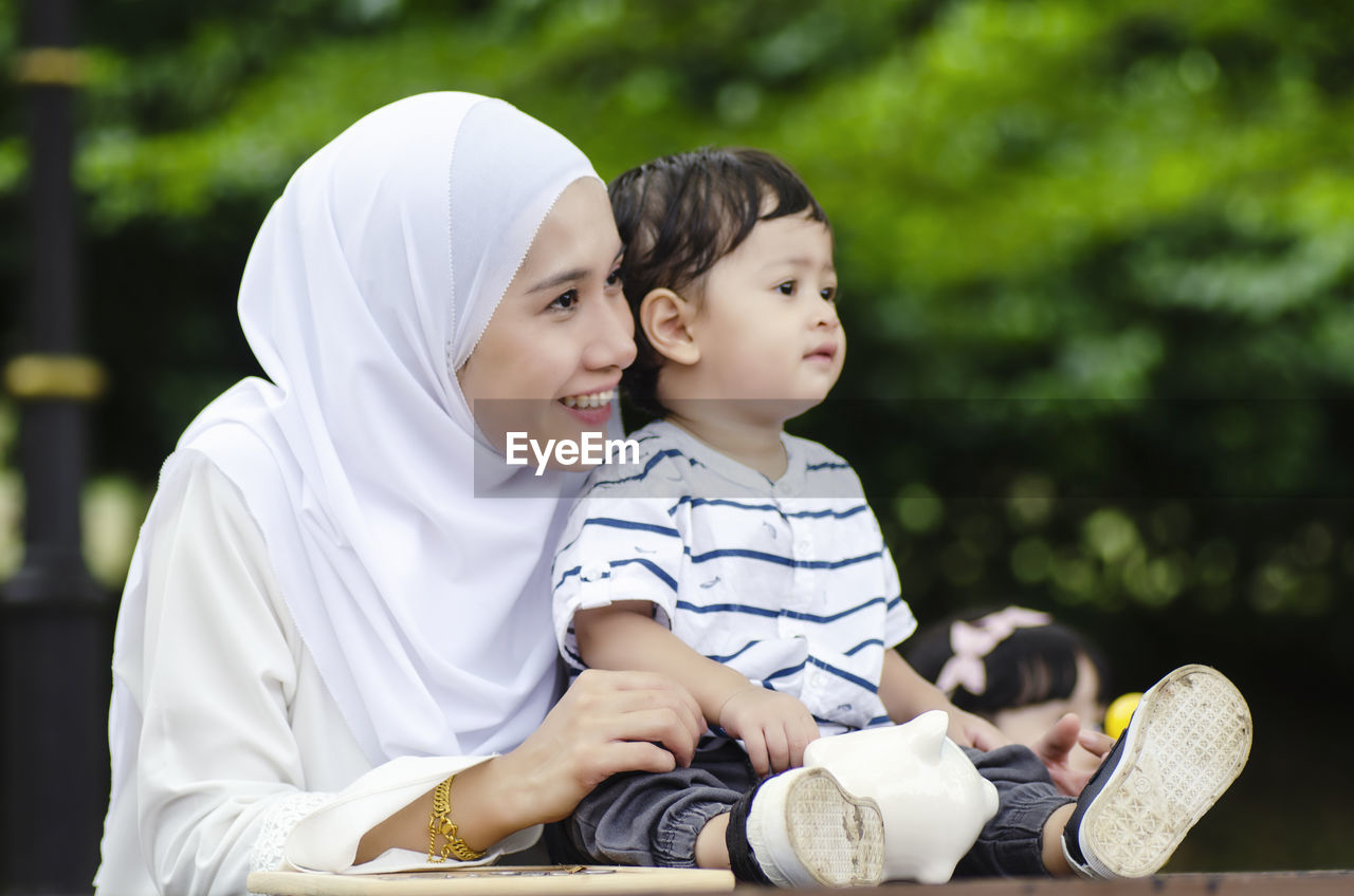 child, childhood, family, males, men, boys, togetherness, bonding, parent, real people, family with one child, emotion, casual clothing, focus on foreground, innocence, mother, leisure activity, son, positive emotion
