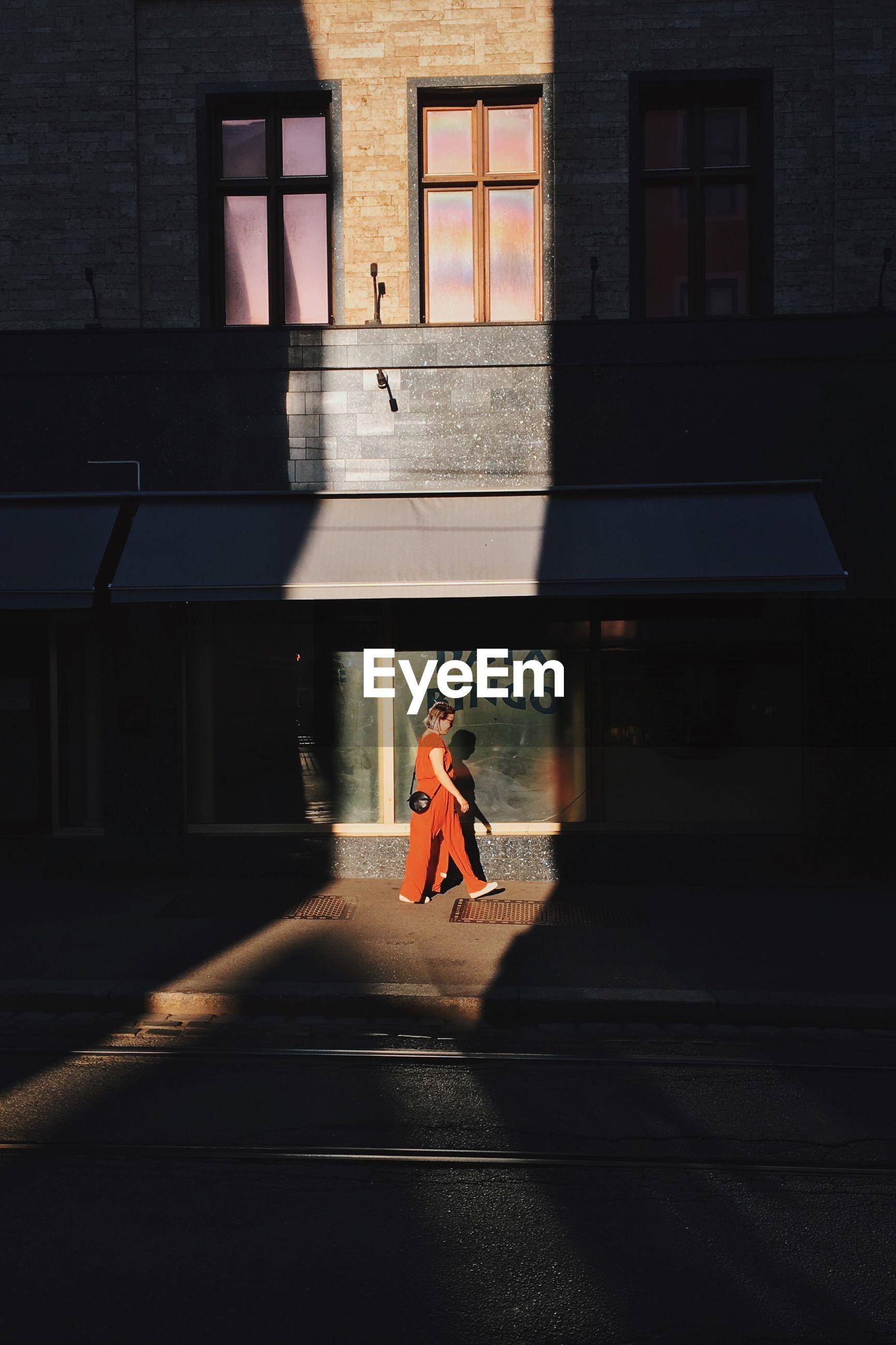 Side view of woman walking on street