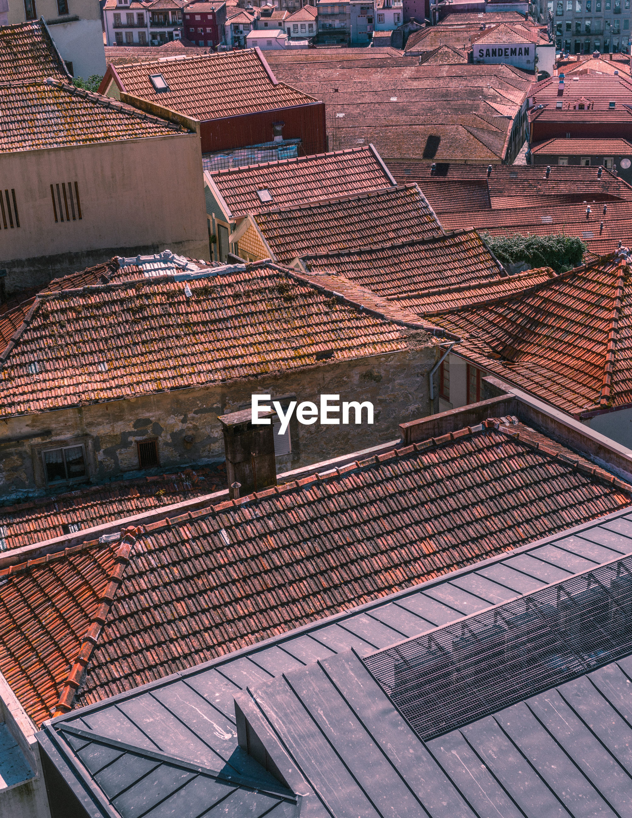HIGH ANGLE VIEW OF ROOF TILES IN CITY