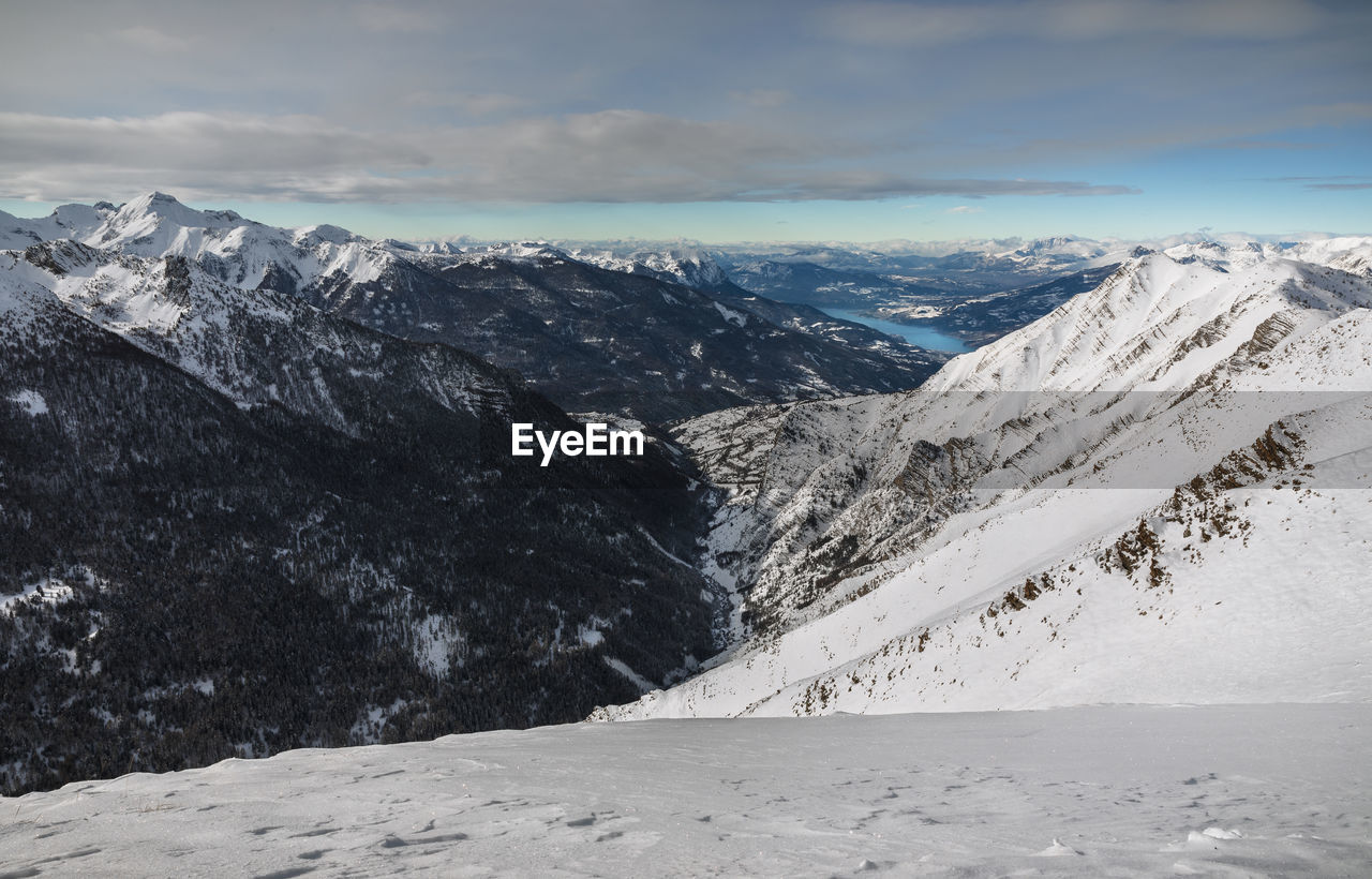 From the summit of the ratelle, the breathtaking view of serre-ponçon lake , hautes alpes, france