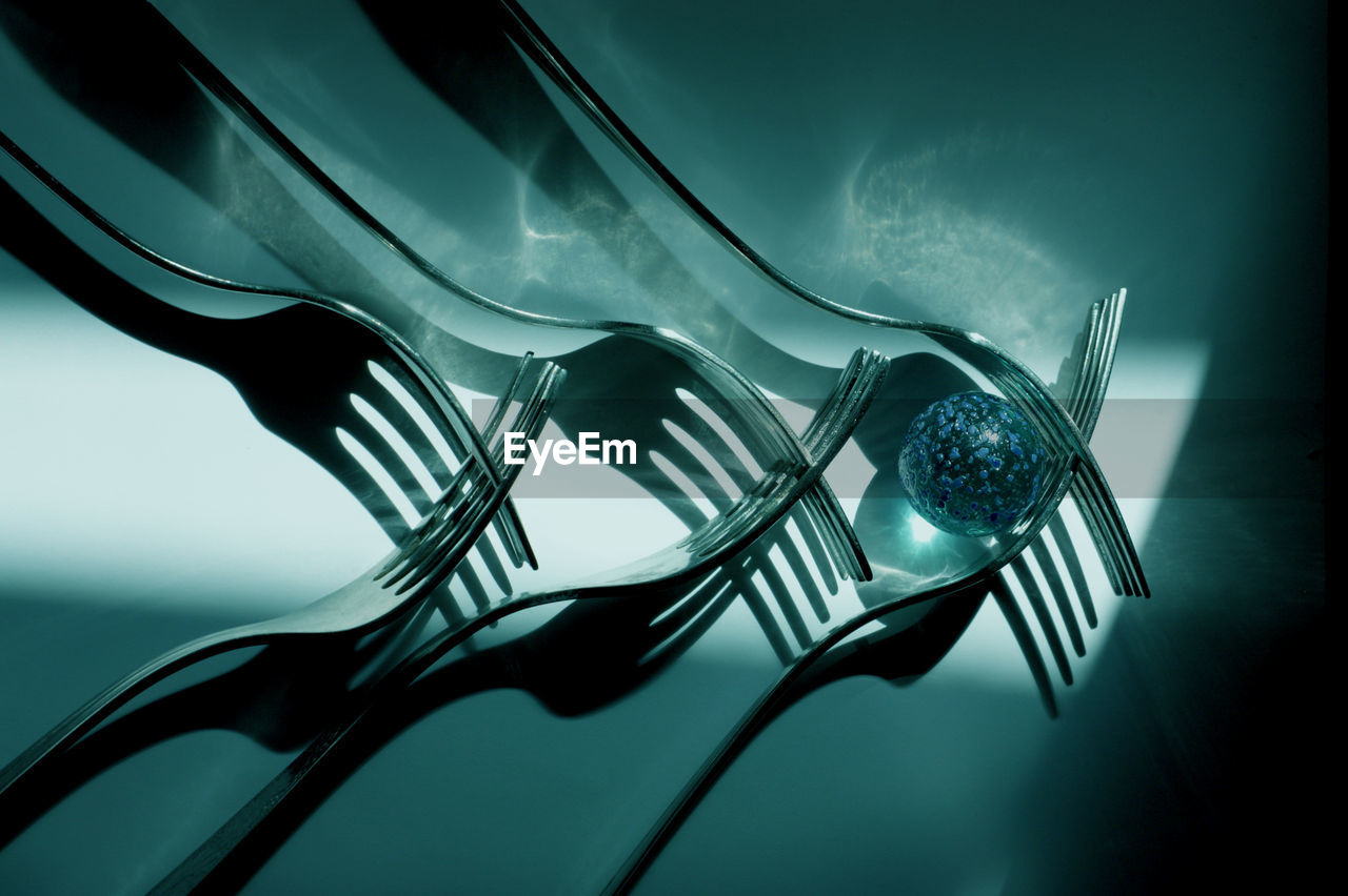 Close-up of forks arranged on table
