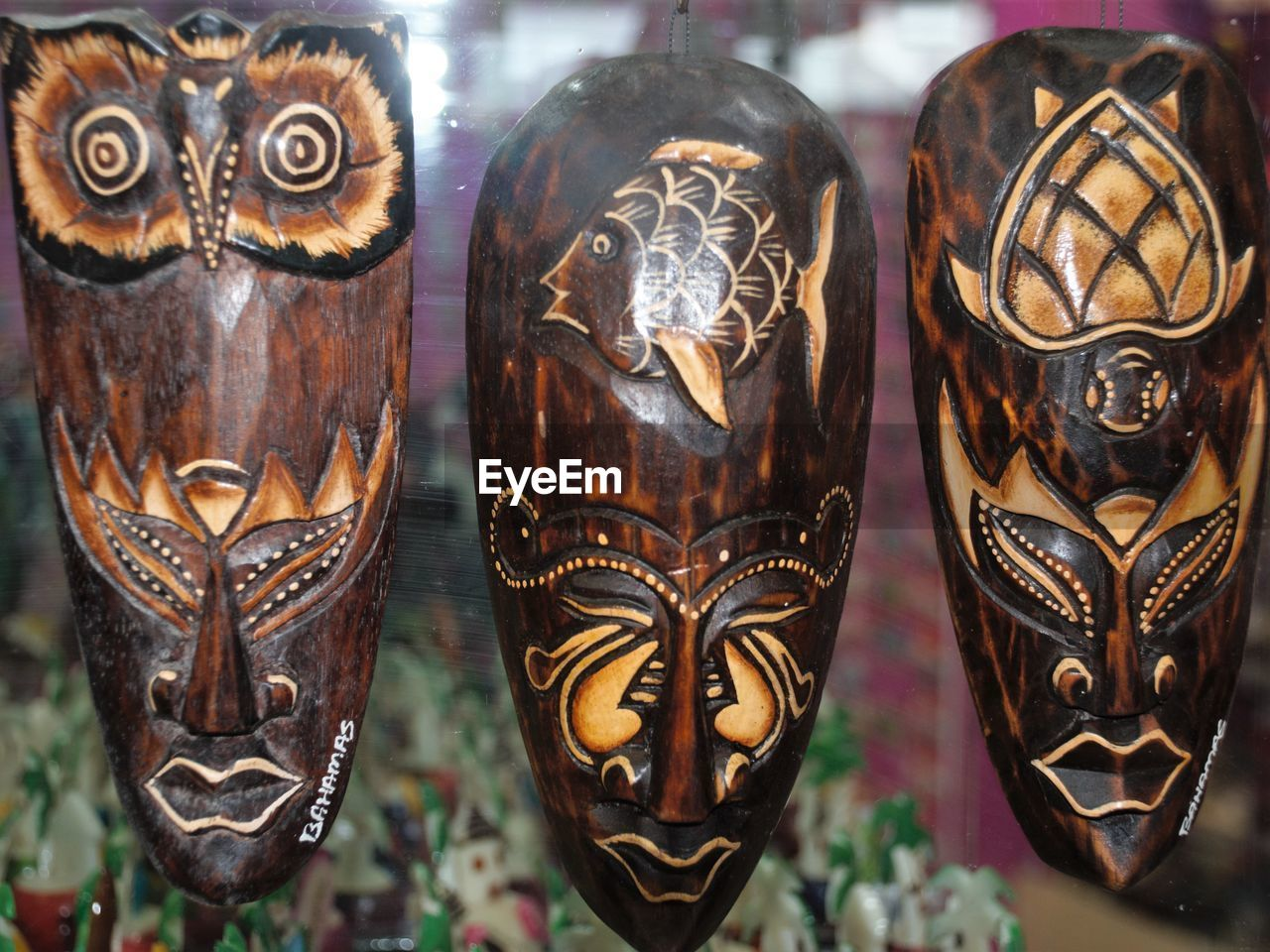 art and craft, close-up, creativity, no people, representation, focus on foreground, indoors, mask - disguise, disguise, mask, human representation, craft, carving - craft product, day, side by side, wood - material, retail, religion, ornate, antique