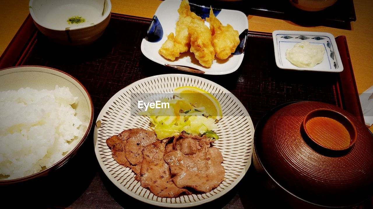 food and drink, food, plate, ready-to-eat, table, indoors, freshness, high angle view, serving size, rice - food staple, healthy eating, bowl, meat, no people, meal, chopsticks, close-up, day