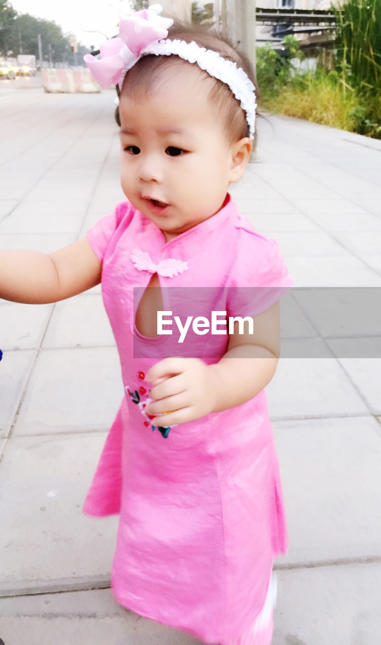 childhood, elementary age, cute, innocence, girls, person, boys, pink color, looking at camera, casual clothing, holding, portrait, toddler, lifestyles, front view, full length, leisure activity, baby
