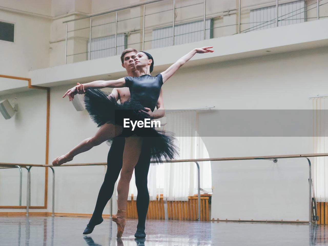 Full Length Of Ballet Dancers Dancing