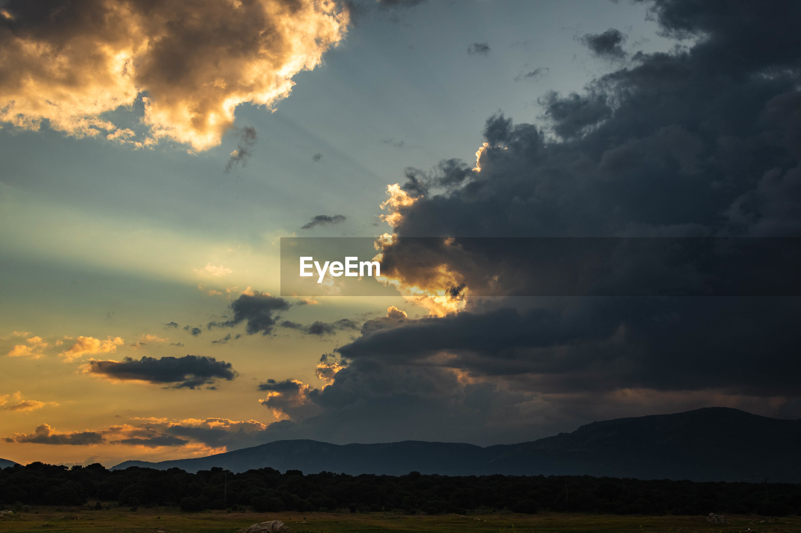 SCENIC VIEW OF SILHOUETTE LANDSCAPE AGAINST DRAMATIC SKY