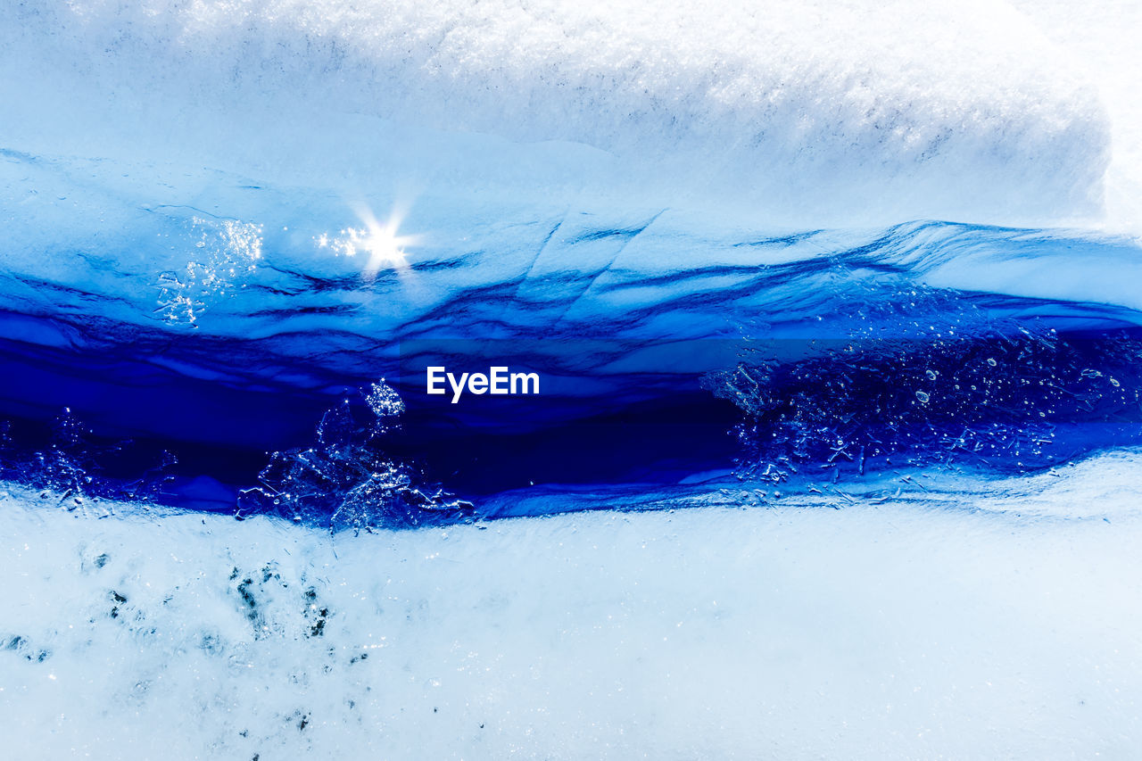 water, blue, cold temperature, nature, winter, motion, close-up, snow, sea, frozen, day, no people, beauty in nature, splashing, ice, outdoors, white color, scenics - nature
