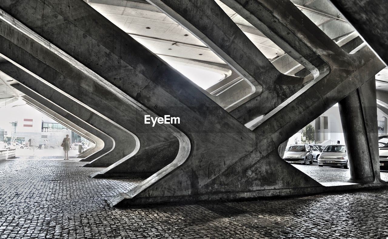 architecture, built structure, bridge - man made structure, transportation, incidental people, connection, day, architectural column, indoors, city