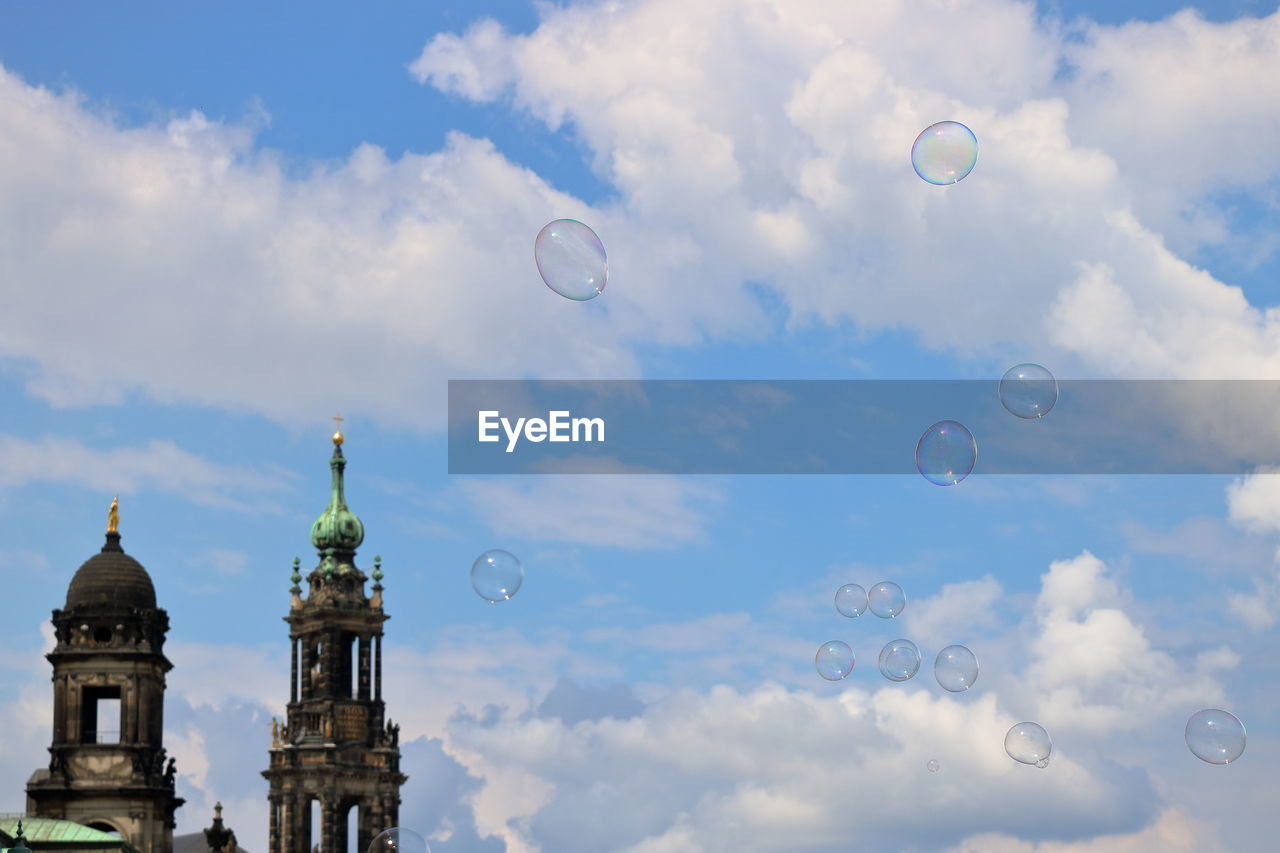bubble, cloud - sky, sky, mid-air, architecture, building exterior, outdoors, flying, built structure, bubble wand, no people, day, fragility, nature, beauty in nature