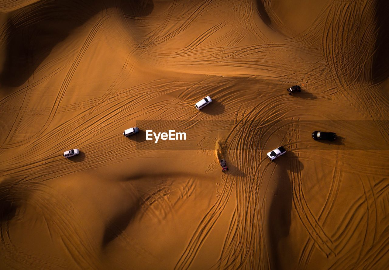 High angle view of vehicles on desert