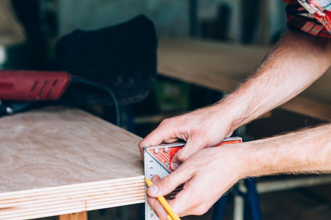 Close-up of carpenter working at workshop