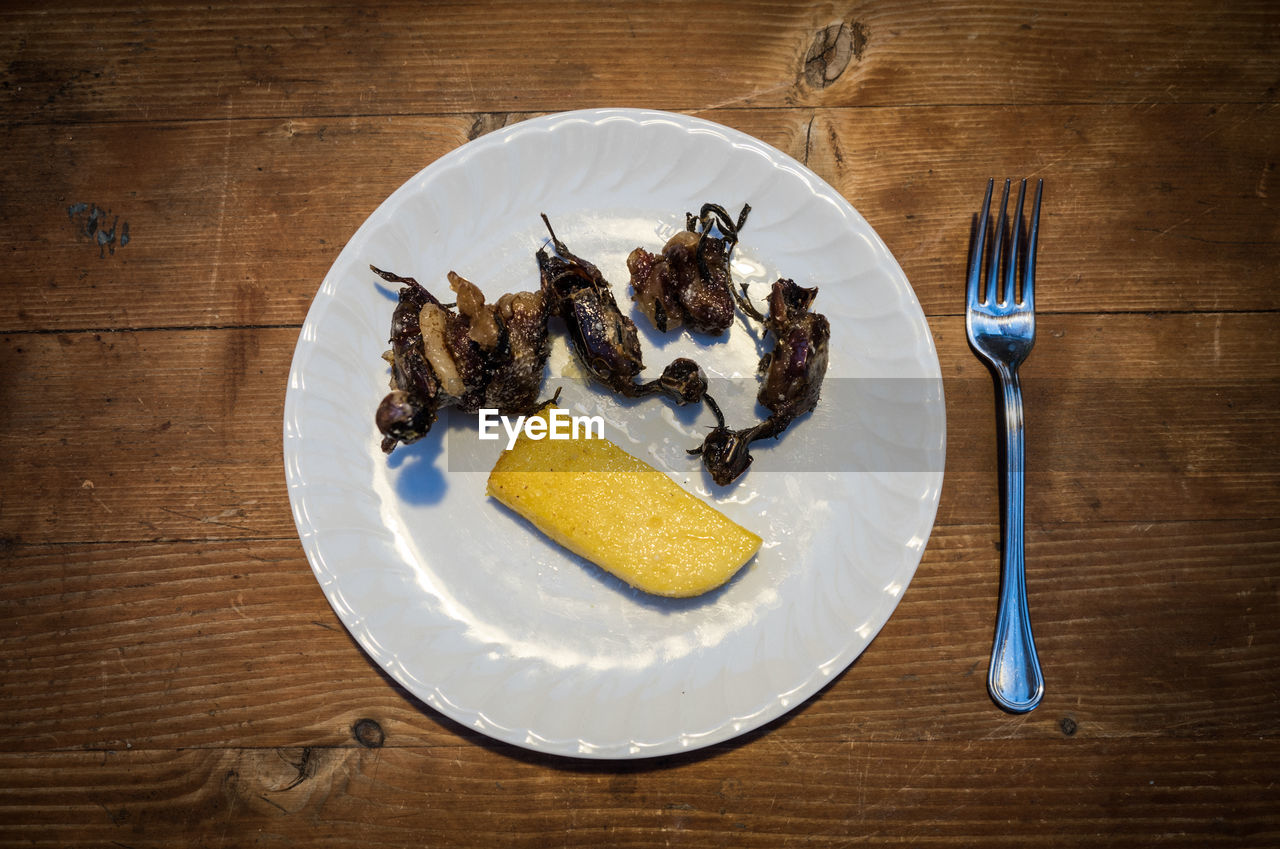 kitchen utensil, eating utensil, fork, table, food and drink, food, plate, ready-to-eat, wood - material, indoors, directly above, freshness, still life, no people, knife, indulgence, high angle view, close-up, sweet food, sweet, table knife, temptation, breakfast