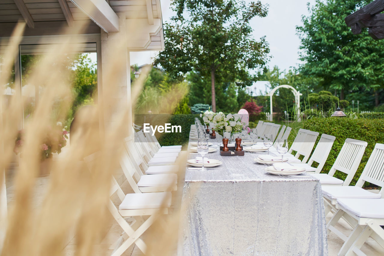 VIEW OF PEOPLE ON TABLE IN YARD