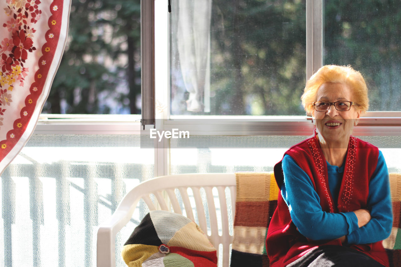 Smiling senior woman sitting at home