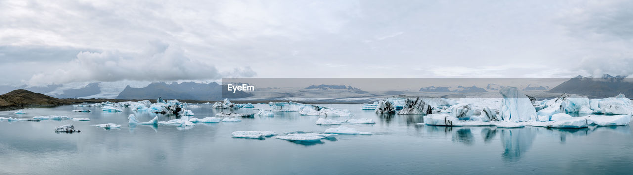 Panoramic view of icebergs melting in glacier