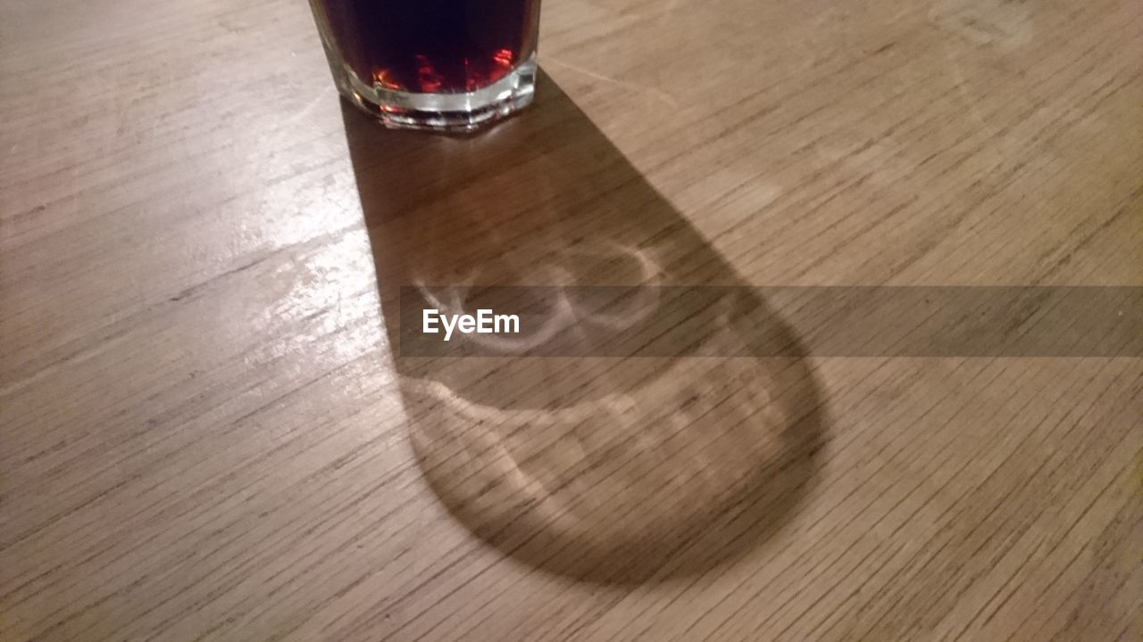 wood - material, table, alcohol, drinking glass, drink, food and drink, hardwood floor, wine, high angle view, refreshment, no people, indoors, wooden floor, shadow, wineglass, day, close-up, freshness