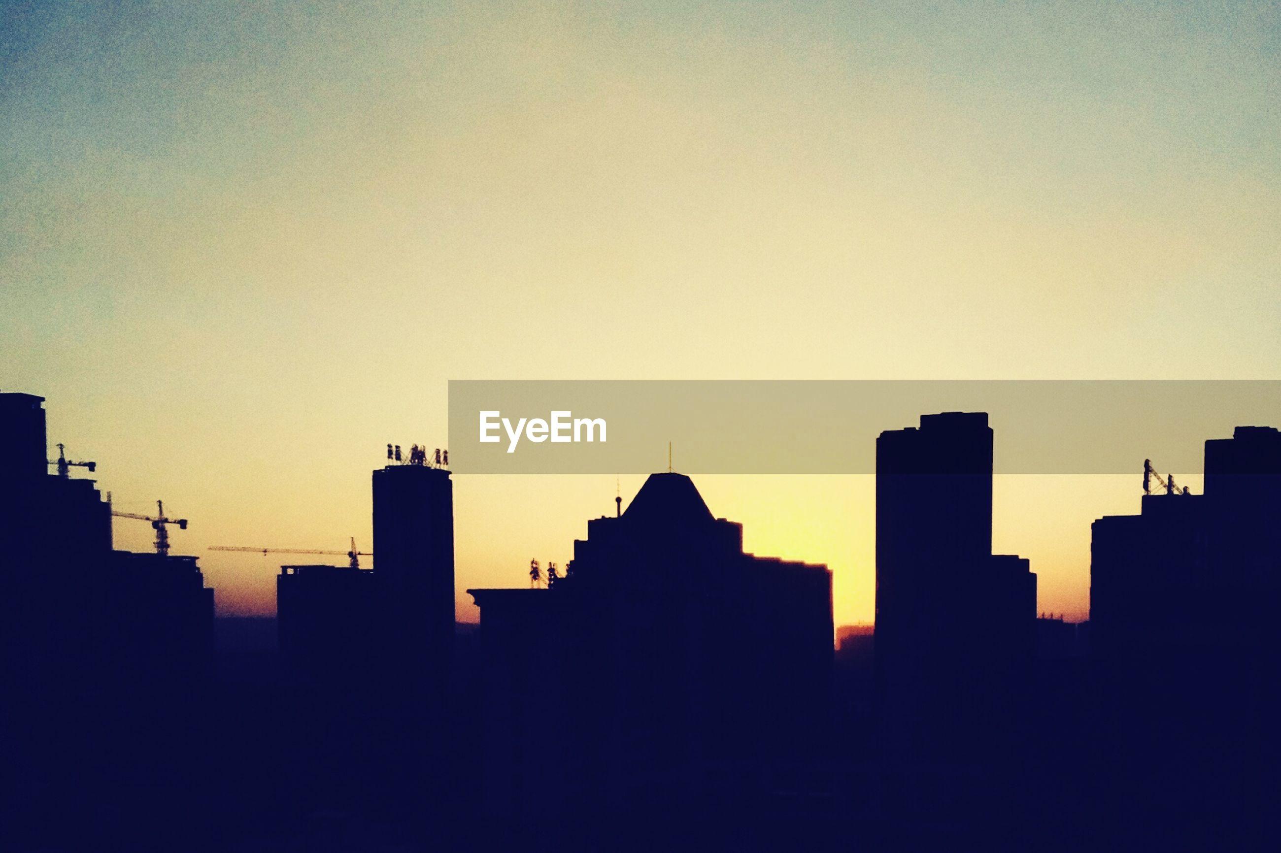 building exterior, silhouette, architecture, sunset, built structure, copy space, clear sky, city, skyscraper, cityscape, urban skyline, skyline, building, orange color, outline, outdoors, dusk, tower, no people, dark