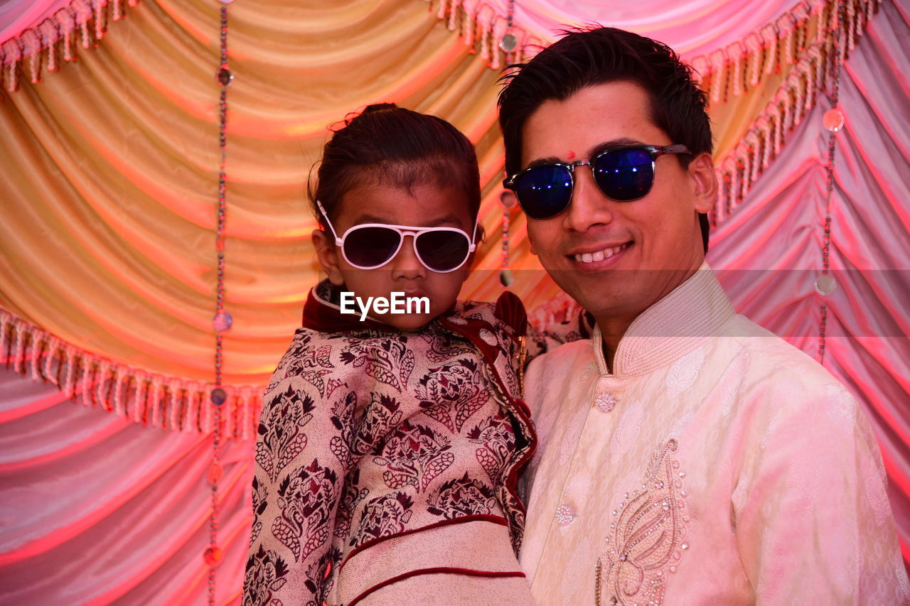 Portrait Of Father And Son Wearing Sunglasses During Celebration