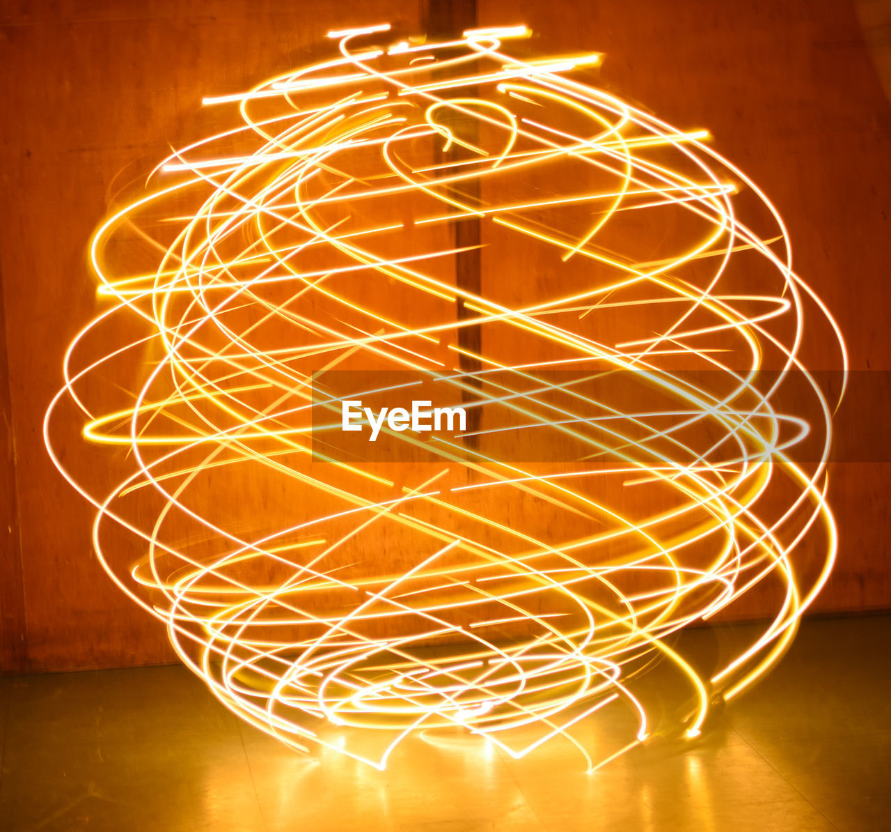 illuminated, long exposure, glowing, night, light trail, light painting, orange color, wire wool, motion, lighting equipment, burning, pattern, flame, indoors, speed, no people, electricity, yellow, close-up