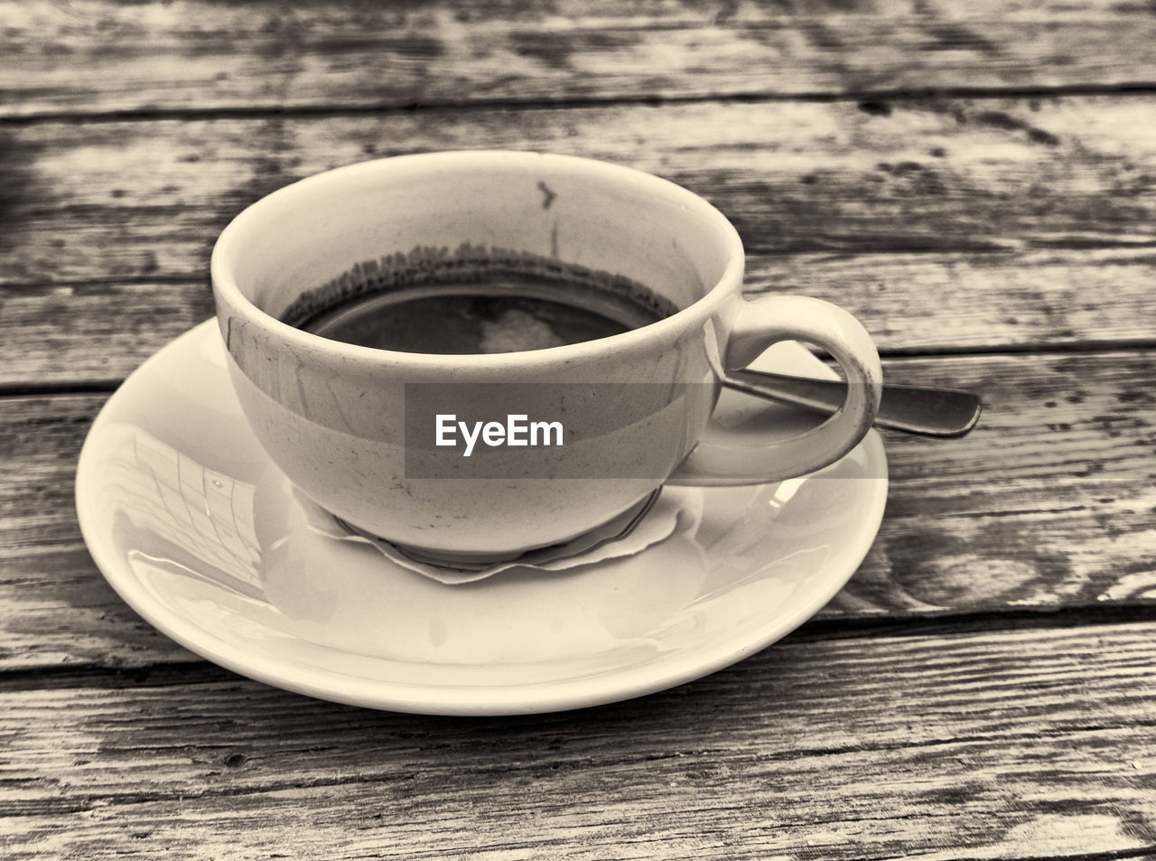 drink, crockery, refreshment, table, saucer, mug, coffee, food and drink, cup, close-up, wood - material, coffee cup, coffee - drink, still life, no people, freshness, hot drink, food, spoon, day, non-alcoholic beverage, tea cup