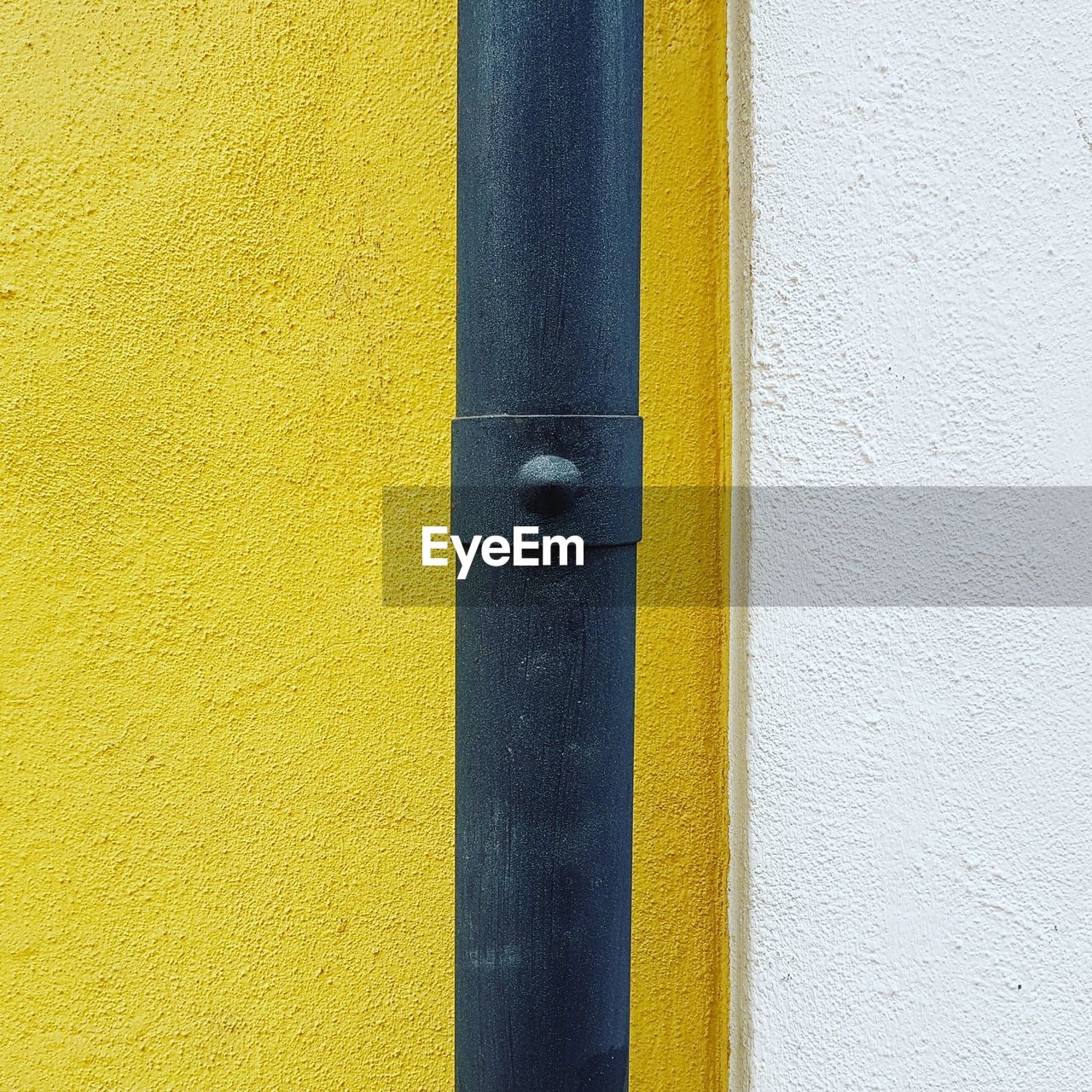 yellow, wall - building feature, built structure, architecture, building exterior, no people, day, close-up, pipe - tube, textured, white color, outdoors, pipeline, wood - material, pipe, metal, wall, pattern, detail, door, concrete