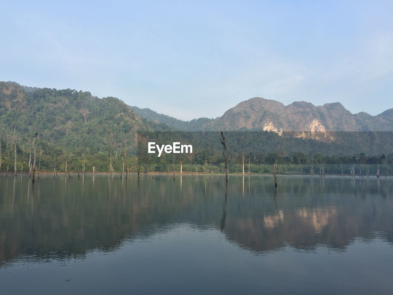reflection, water, mountain, lake, tranquil scene, scenics, tranquility, nature, beauty in nature, no people, tree, outdoors, day, waterfront, mountain range, sky