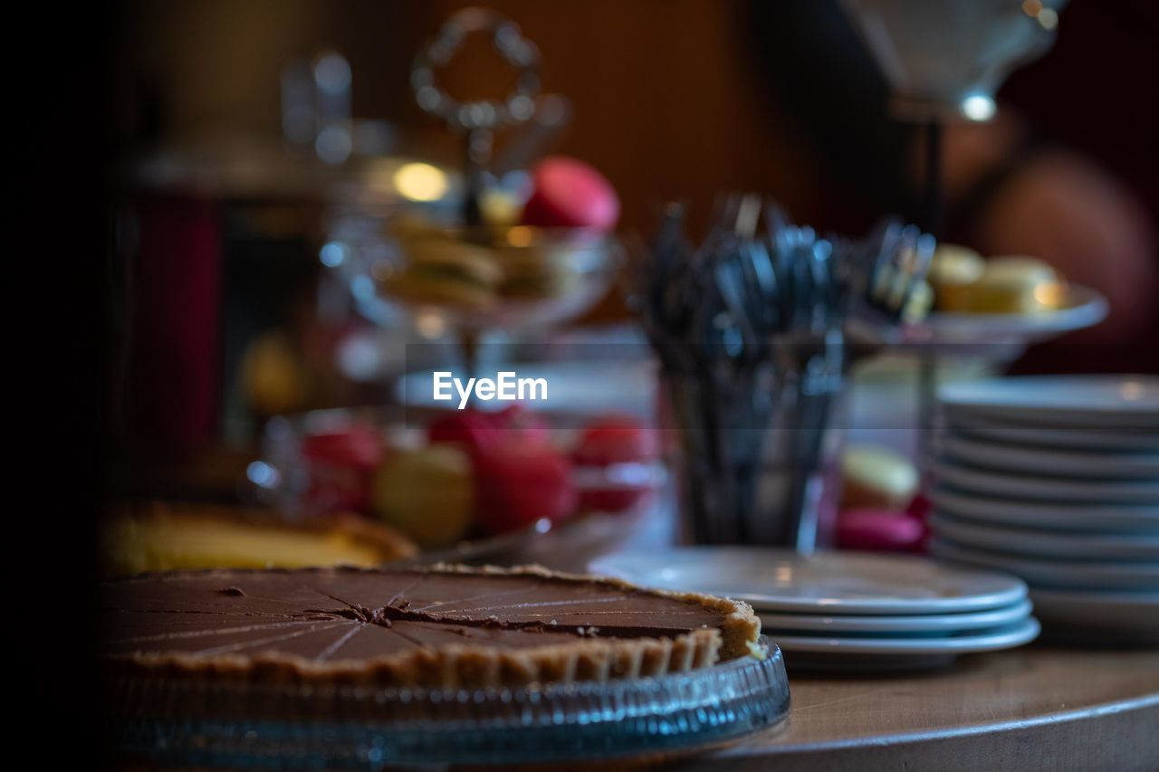 table, plate, food and drink, food, indoors, still life, no people, freshness, sweet food, ready-to-eat, dessert, selective focus, eating utensil, sweet, cake, fork, baked, kitchen utensil, glass, indulgence, temptation, crockery, setting, breakfast