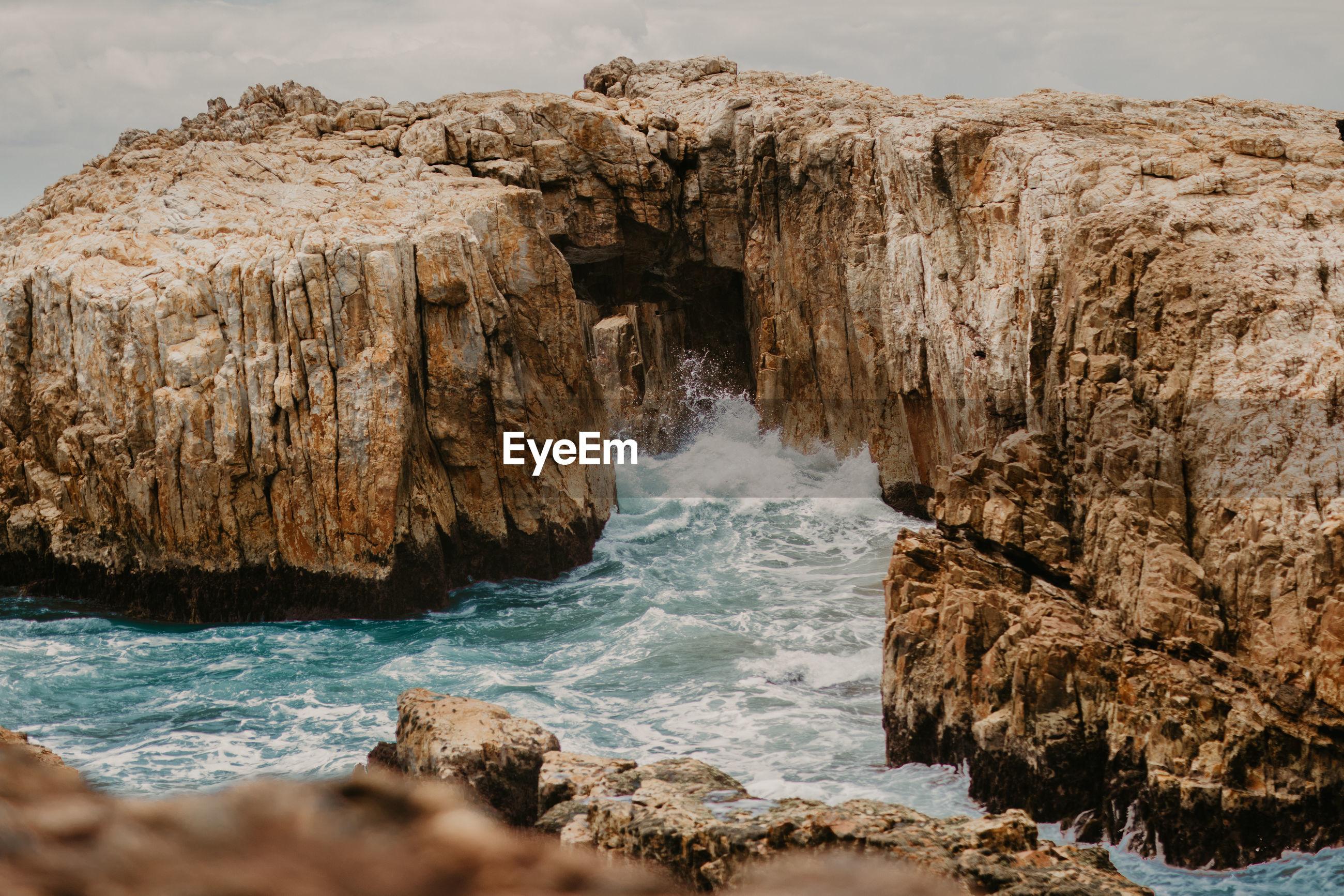 SCENIC VIEW OF ROCKS IN SEA