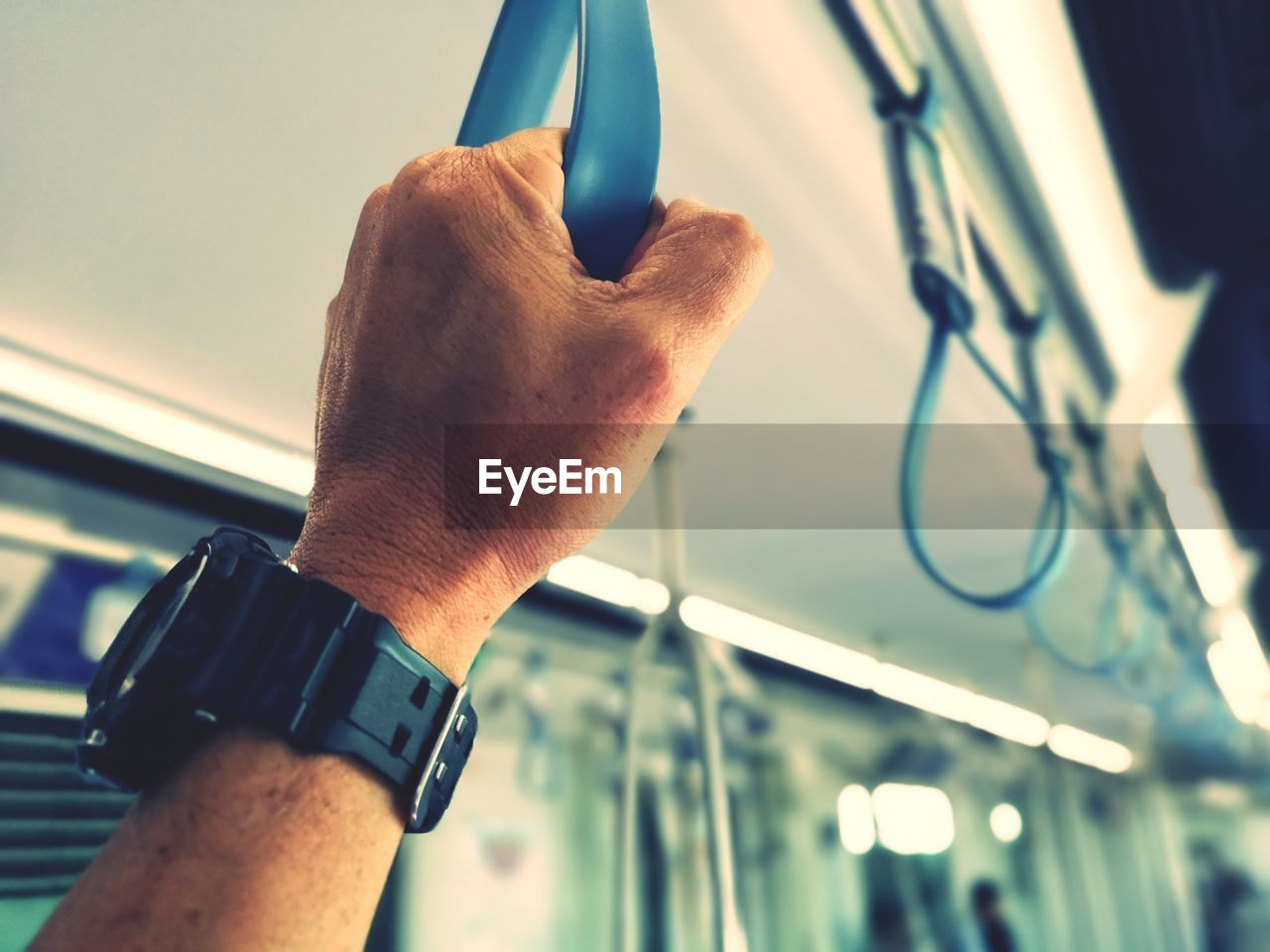 human hand, hand, human body part, real people, focus on foreground, one person, men, close-up, wristwatch, day, lifestyles, holding, personal perspective, watch, time, finger, human finger, body part, outdoors, human limb, personal accessory