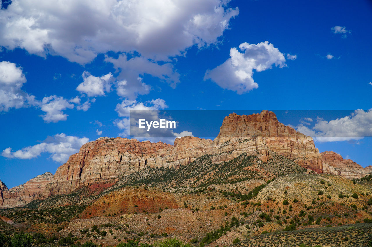 cloud - sky, sky, rock formation, scenics - nature, rock, mountain, rock - object, tranquil scene, non-urban scene, physical geography, tranquility, beauty in nature, solid, nature, environment, travel destinations, geology, landscape, no people, rocky mountains, formation, mountain range, outdoors, arid climate, climate, eroded